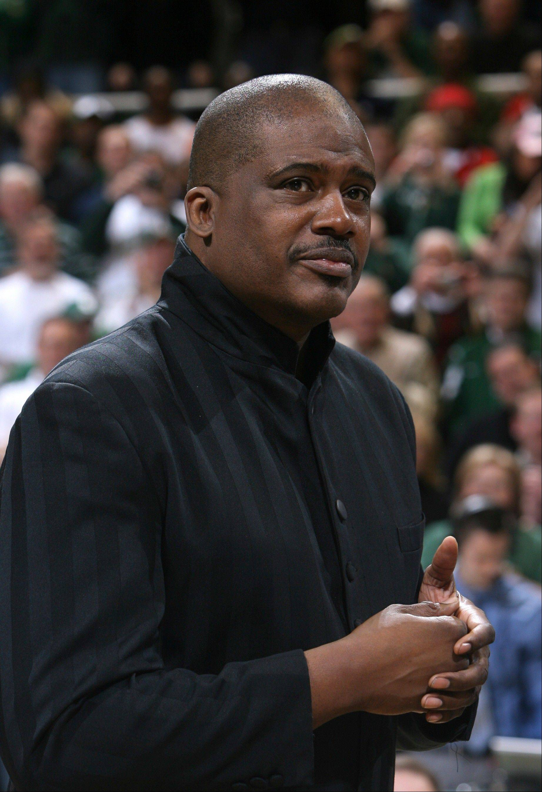 Jay Vincent is shown as he joins members of Michigan State�s 1979 NCAA championship basketball team during a ceremony commemorating the 30th anniversary of the championship during halftime of an NCAA college basketball game between Michigan State and Wisconsin, in East Lansing, Mich. Former NBA star Magic Johnson is asking a judge for �mercy� and no prison for college teammate Vincent, who is facing years behind bars for fraud.