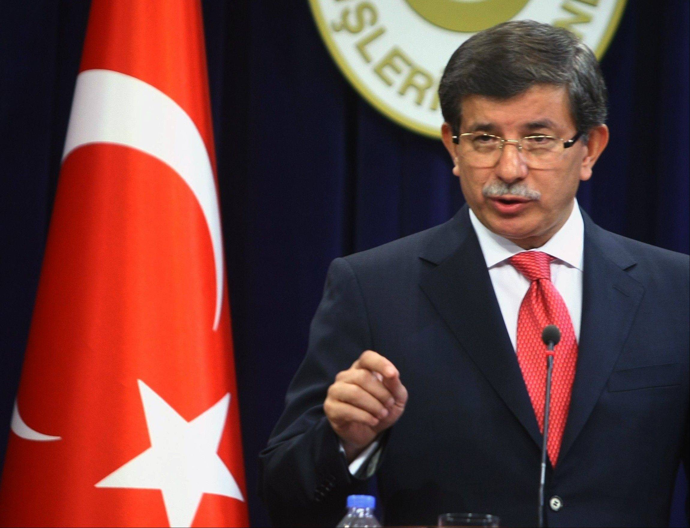 Turkish Foreign Minister Ahmet Davutoglu speaks to the media in Ankara, Turkey, Friday, Sept. 2, 2011. Turkey said Friday it was expelling the Israeli ambassador and cutting military ties with Israel over the last year's deadly raid on a Gaza-bound aid flotilla, further souring the key Mideast relationship between Turkey and Israel. Davutoglu said Turkey was downgrading diplomatic ties to the level of second secretary and that the ambassador and other high-level diplomats would leave the capital Ankara by Wednesday.(AP Photo)