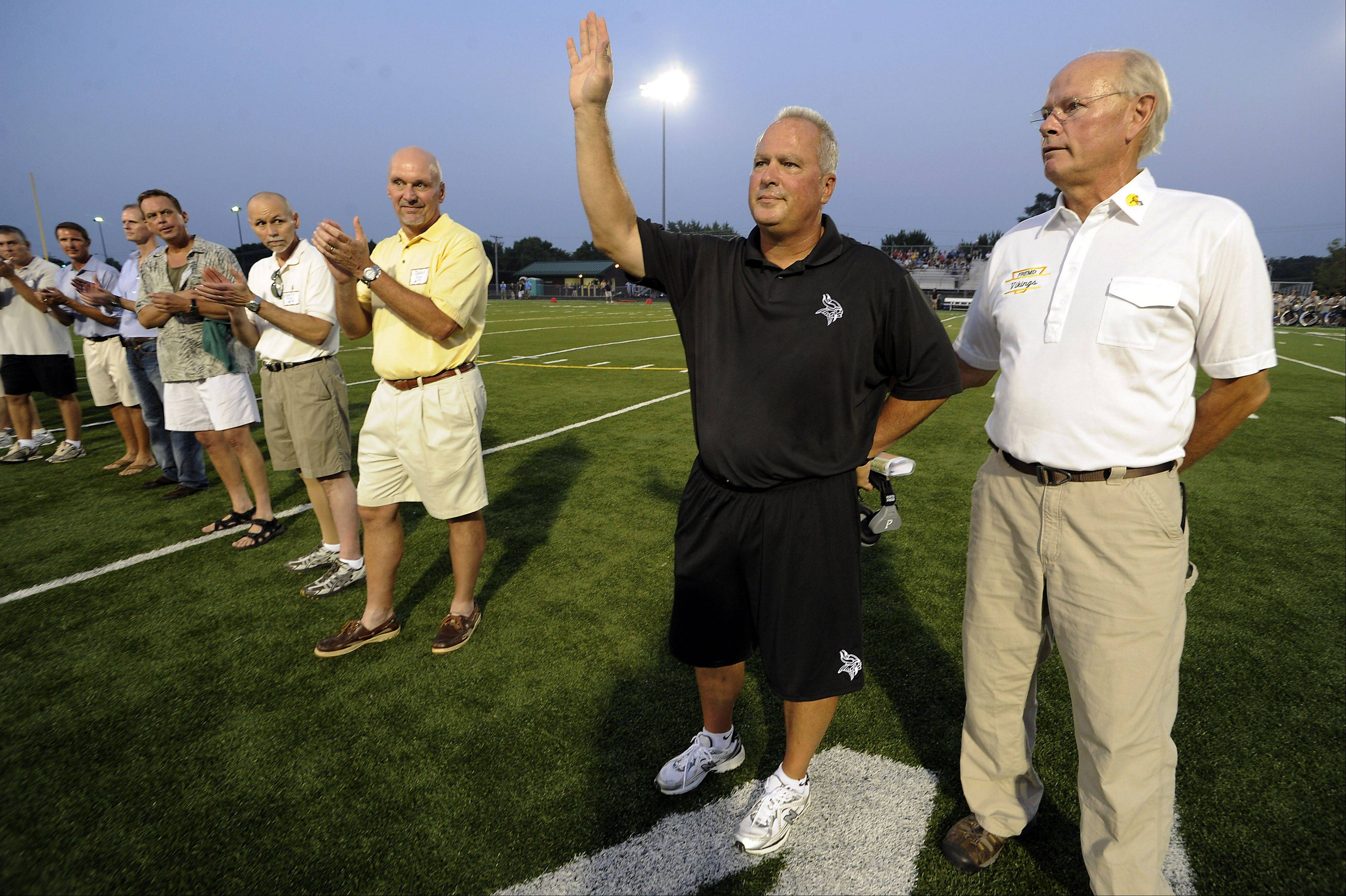 Fremd High School�s football head coach Michael Donatucci waves to the crowd as they announce the former players before the game honoring the greatest players in Fremd�s history.