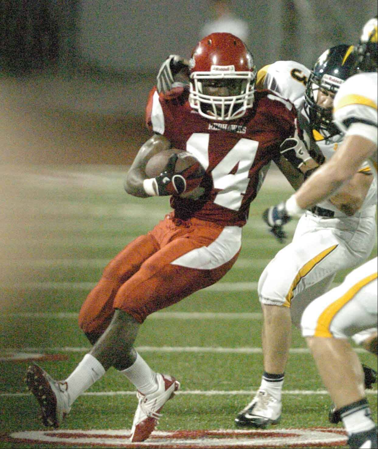Lesoda Thompson of Naperville on the move during the Neuqua Valley at Naperville Central game Friday.