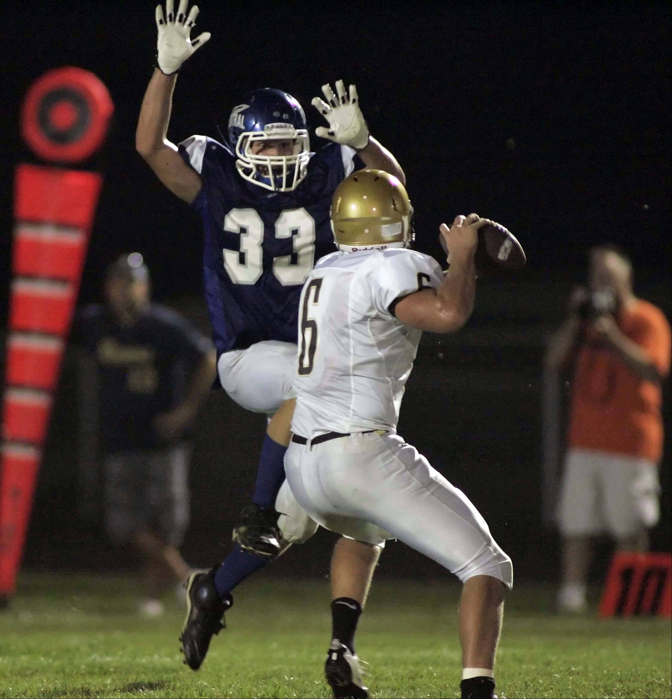 Burlington Central�s Nate Reed (33) puts the pressure on Sycamore�s Ryan Bartels on Friday night on Rocket Hill.