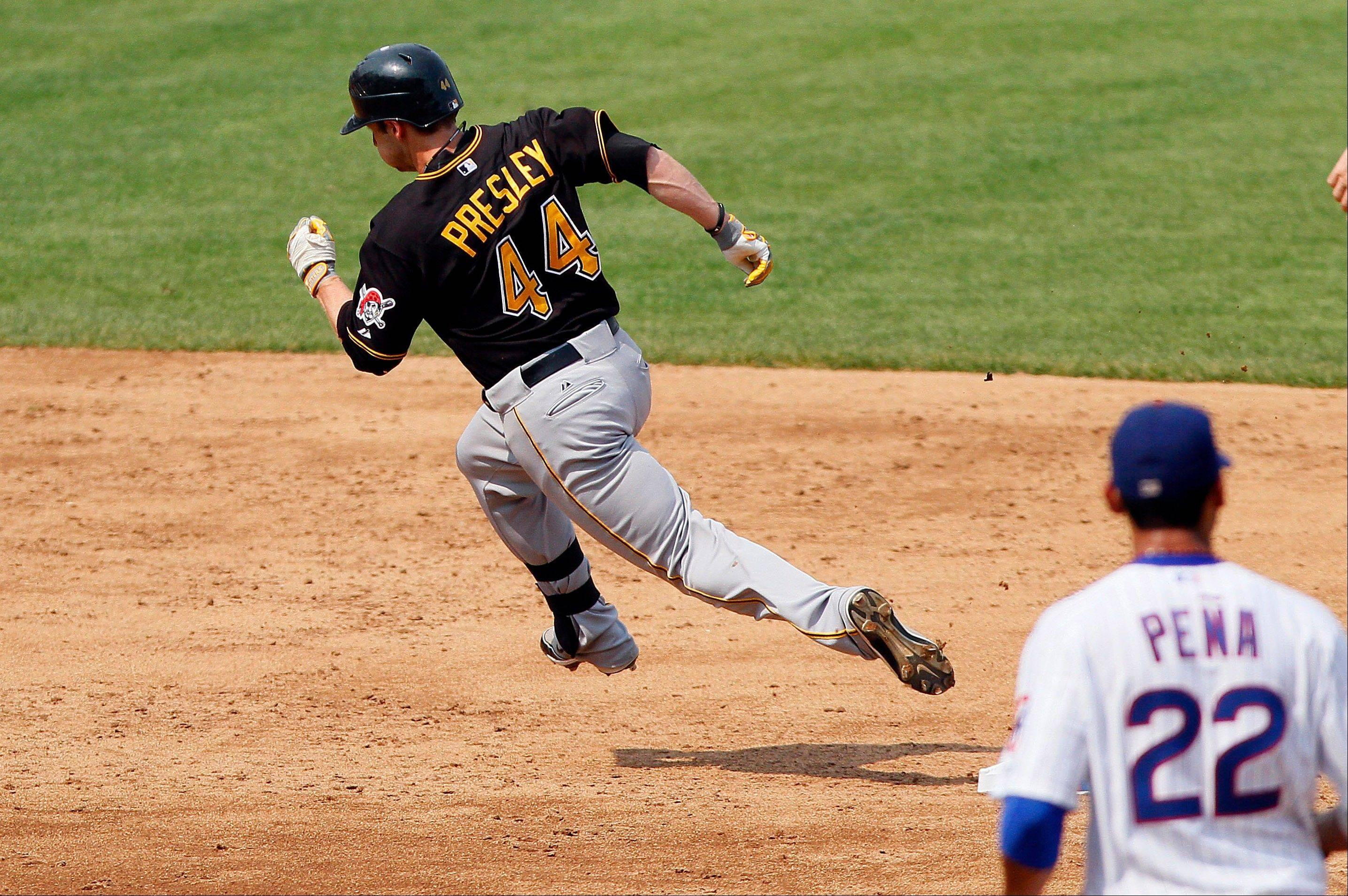 Pittsburgh Pirates' Alex Presley rounds second base and heads to third with a triple. The Cubs had solid starting pitching again from Ryan Dempster, but the offense could do little.