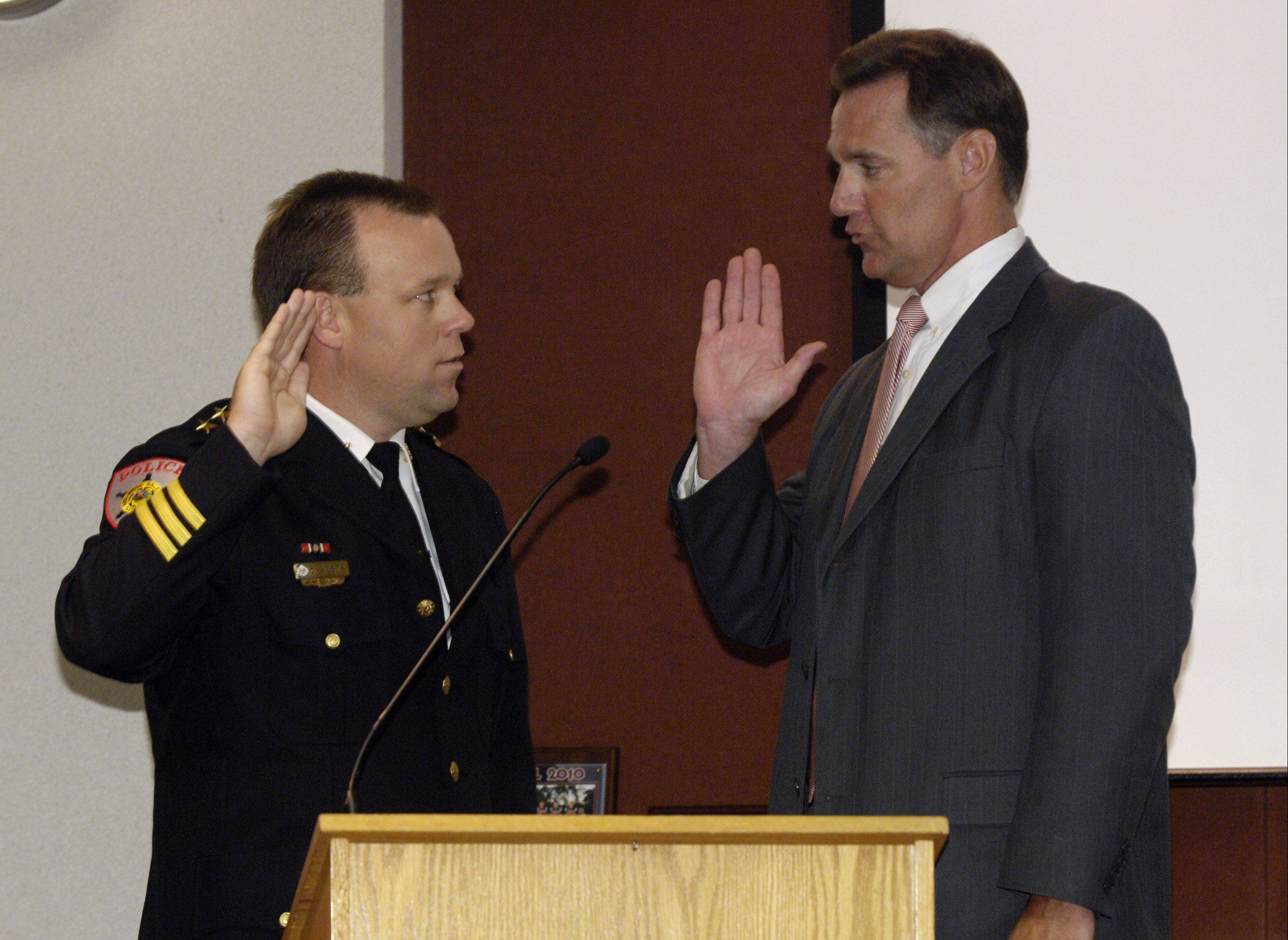 Wood Dale city attorney Patrick Bond swears in Greg Vesta as the new police chief. Greg is a former deputy chief and one of the youngest police chiefs in DuPage County.