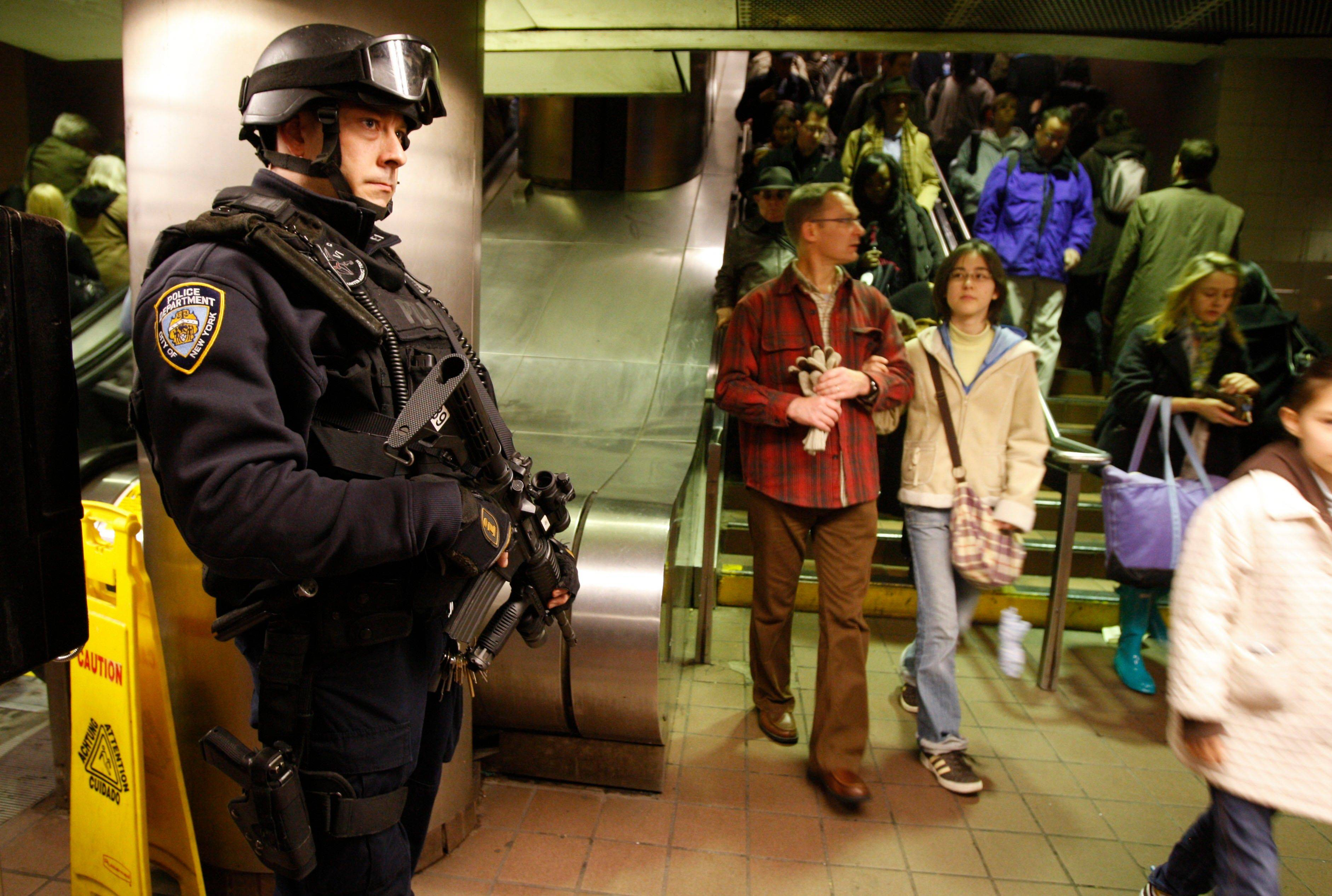 Det. Todd Sessa keeps his eye on commuters entering and exiting the subway system at Grand Central Station in New York as part of �Operation TORCH,� funded by a grant to help beef up 2,600 police officers from the New York Police Department�s transit bureau.