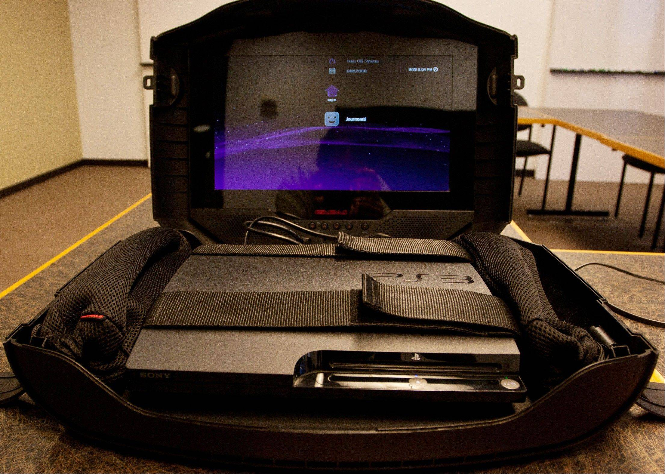 The GAEMS G155, a rugged game console case with a built-in high-definition display, is displayed Monday, Aug. 29, 2011 in Atlanta, Ga. The GAEMS case allows the user to take an Xbox 360 or Sony PlayStation system and accesories on the road.