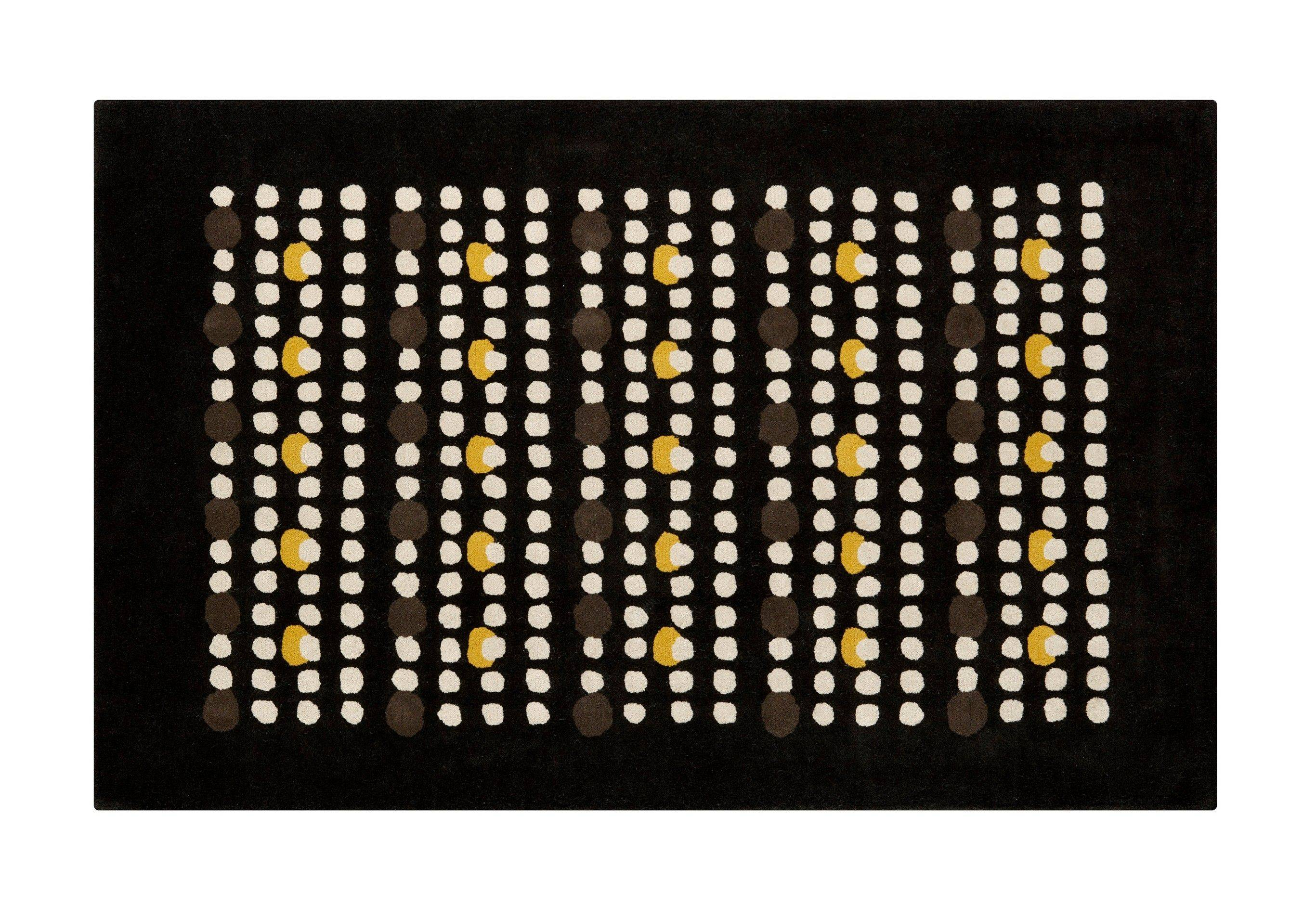 The Bingo Rug from CB2 boasts a black, white and yellow graphic resembling city lights at night.