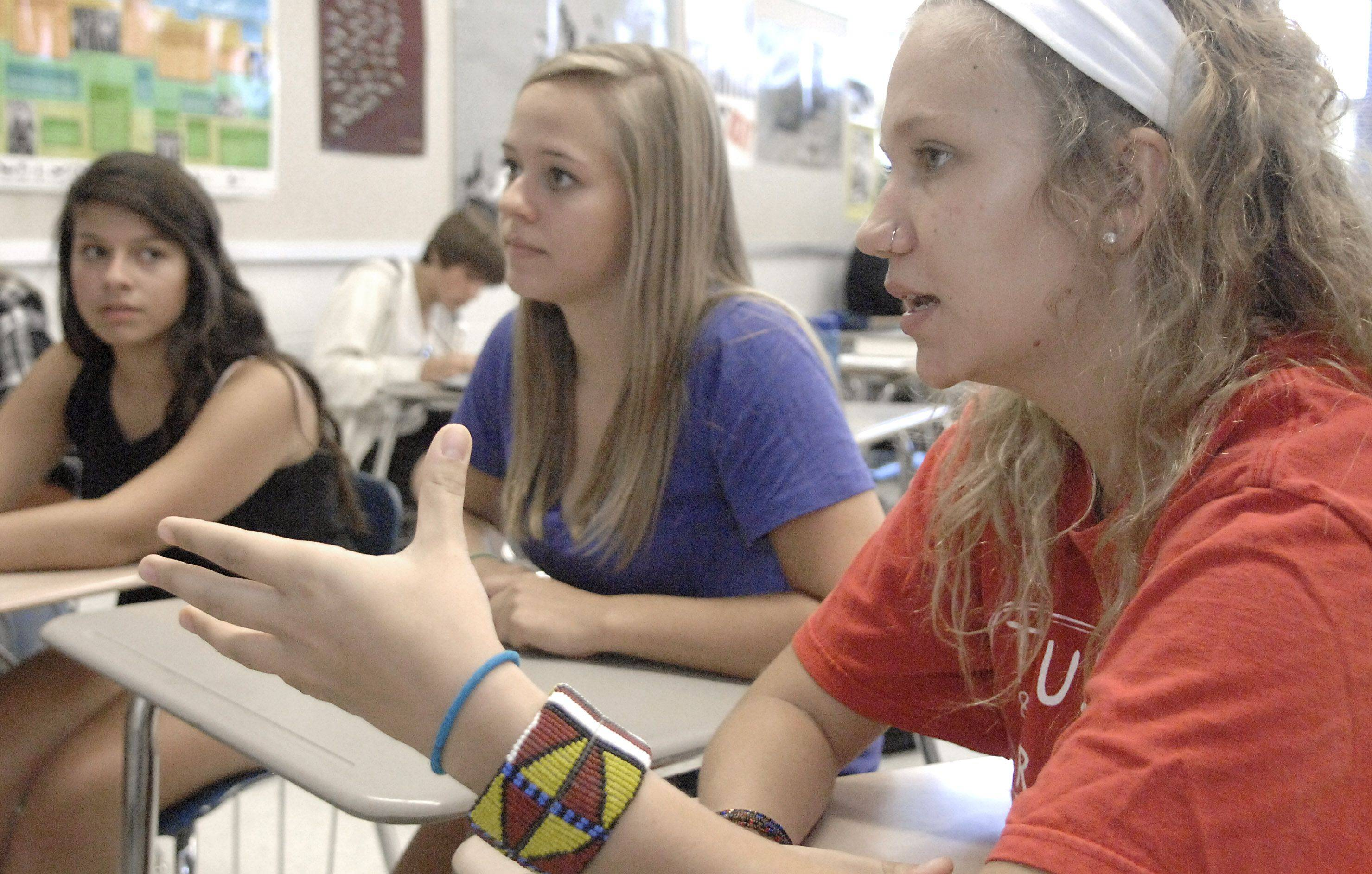Senior Jenny Wolan, 17, of Algonquin talks with Nina Massion, 16, left, and Katie McDonnell, 17, center, of the Youth Labor Committee in a classroom at Dundee-Crown High School in Carpentersville about unfair trade practices. They have been circulating a petition and have already gotten thousands of signatures.