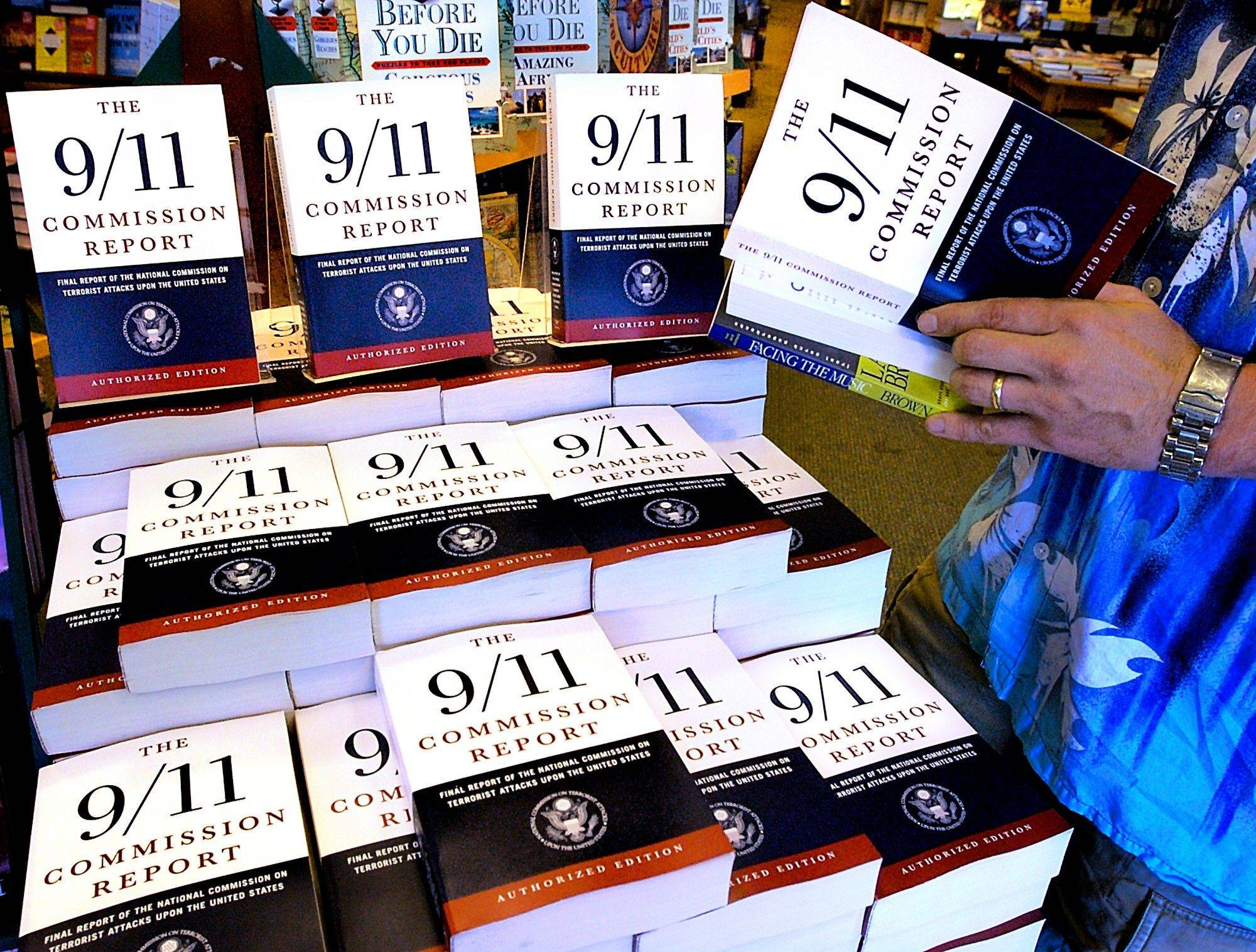 A patron of the Barnes & Noble bookstore in Springfield, Ill., reads a copy of the �The 9/11 Commission Report,� a 585-page road map to create an America that is �safer, stronger, wiser.� Many of the commission�s recommendations are now reality. But in some cases, results haven�t lived up to expectations. And other proposals still are just that, ideas awaiting action.