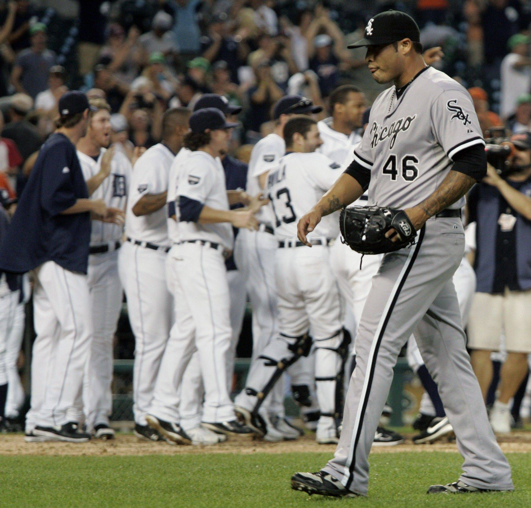 Sergio Santos walks off the field after giving up the game-winning home run to Detroit Tigers' Miguel Cabrera in the ninth inning Saturday in Detroit.