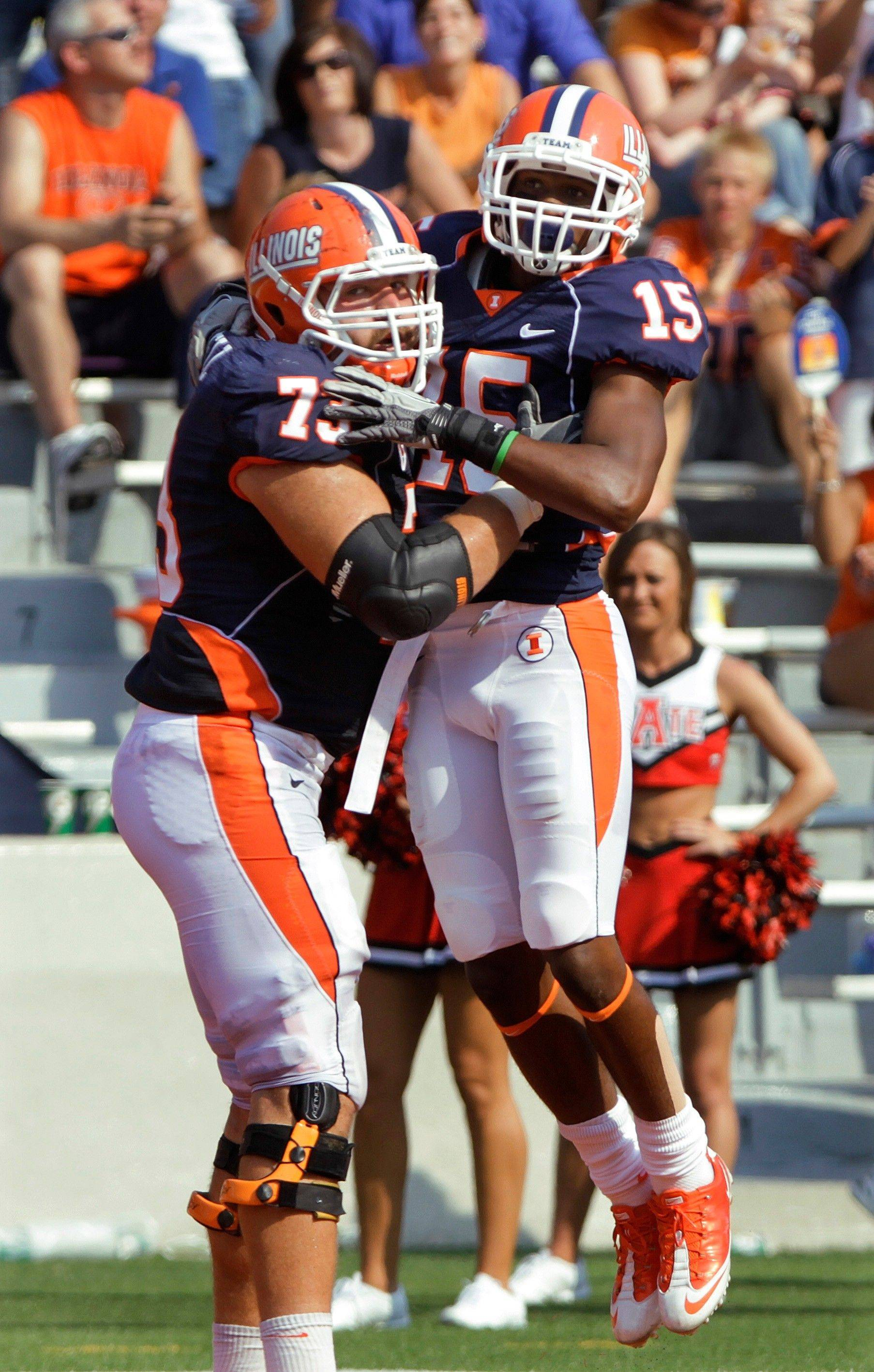 Darius Millines celebrates his touchdown on a long pass with offensive linesman Jack Cornell (73) during the second quarter of Illinois' 33-15 victory over Arkansas State.