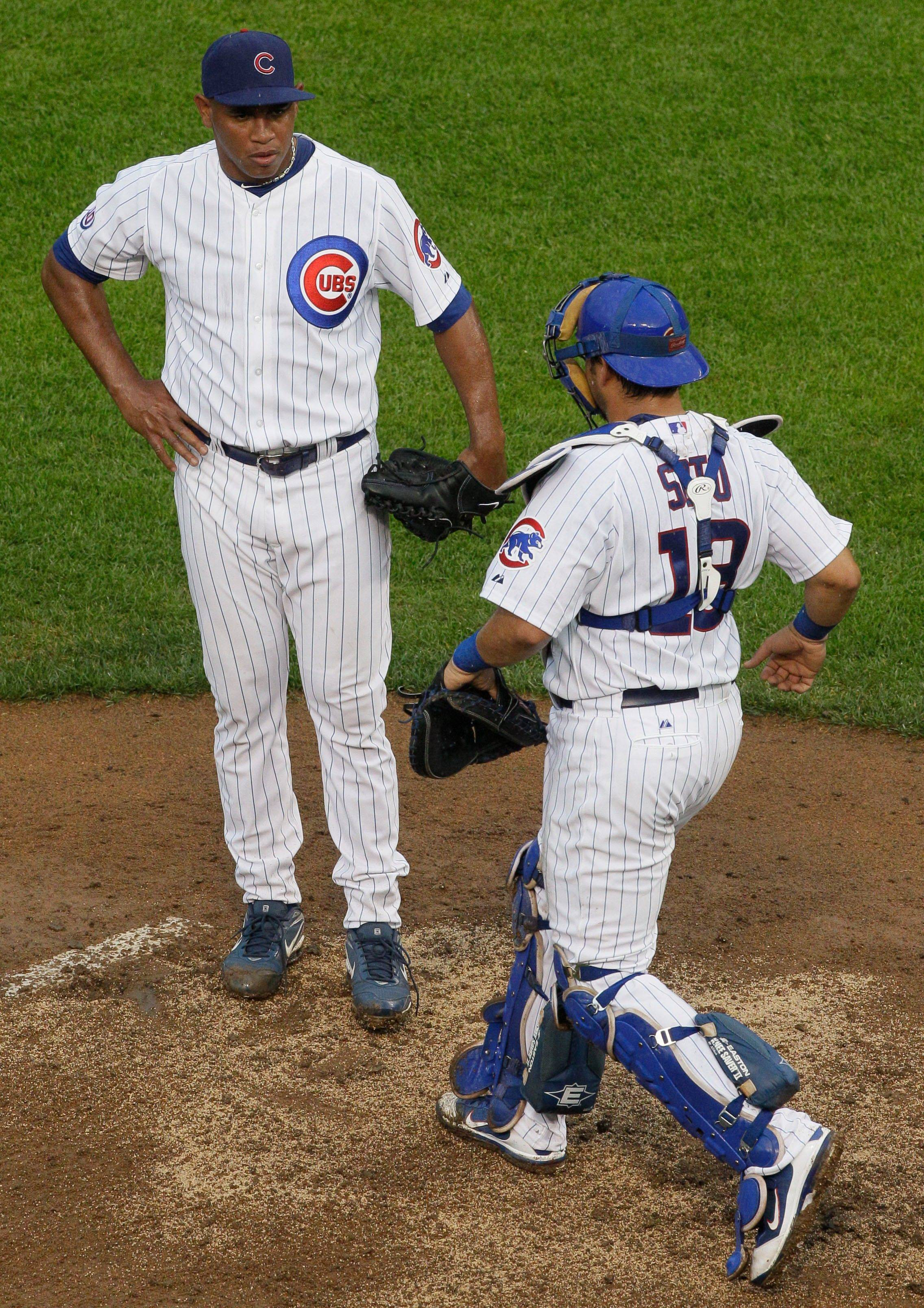 Cubs catcher Geovany Soto talks to closer Carlos Marmol after Derrek Lee hit a grand slam in the ninth inning Saturday to give the Pirates the lead at Wrigley Field.