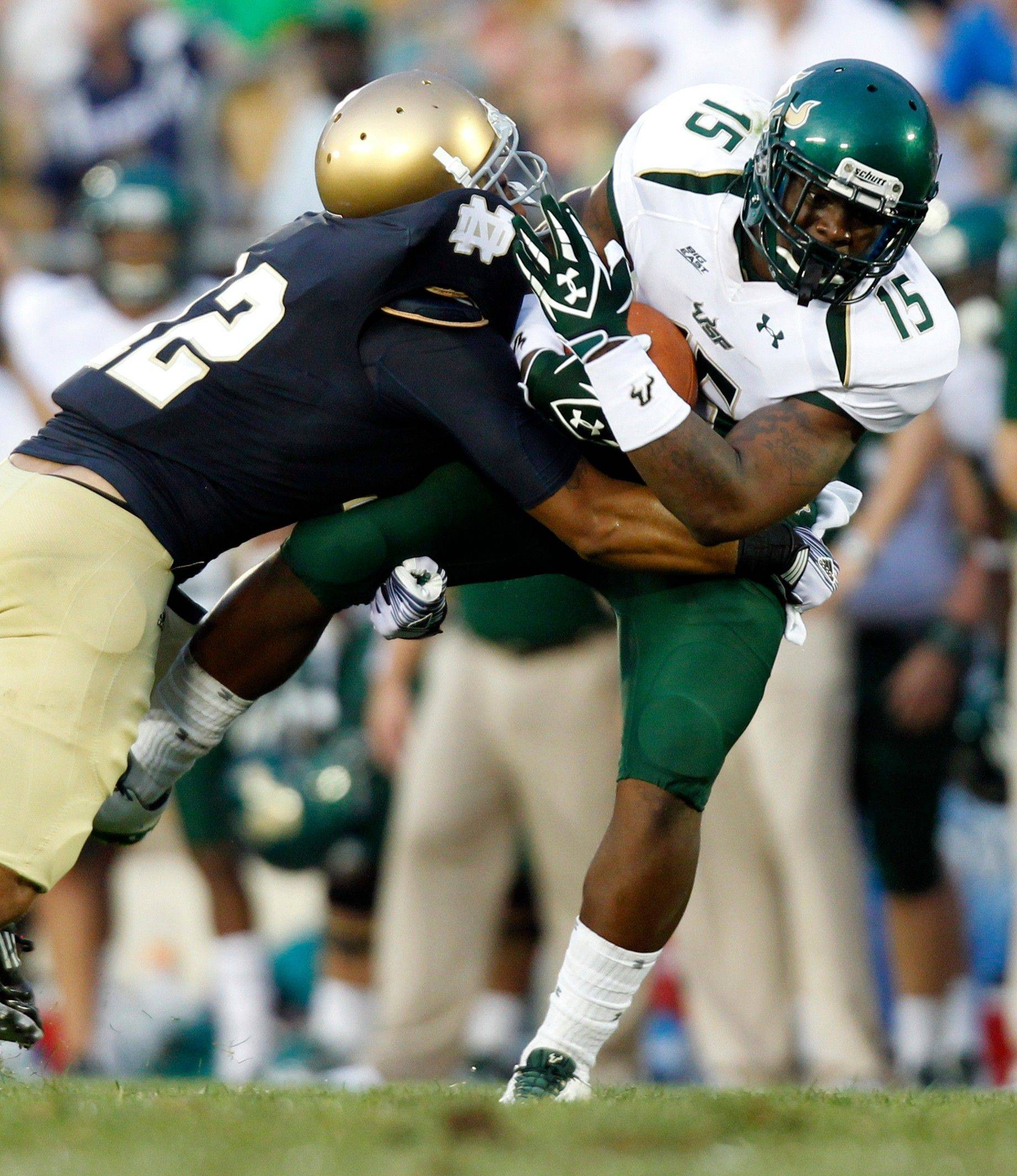 South Florida wide receiver Victor Marc is tackled by Notre Dame cornerback Robert Blanton in the third quarter Saturday.