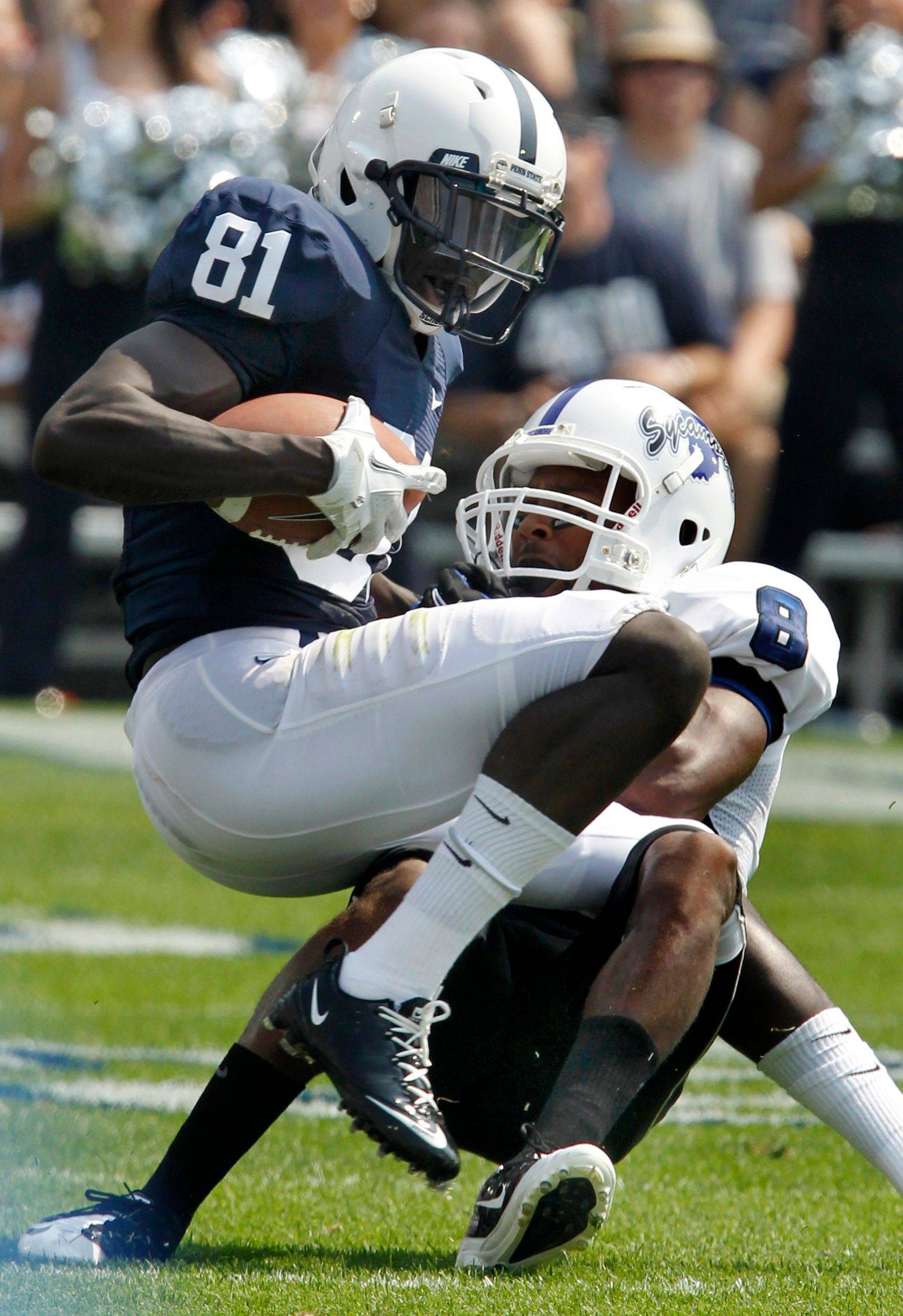 Penn State receiver Shawney Kersey is tackled by Indiana State defender Larry Carter after making after a catch during the third quarter Saturday.