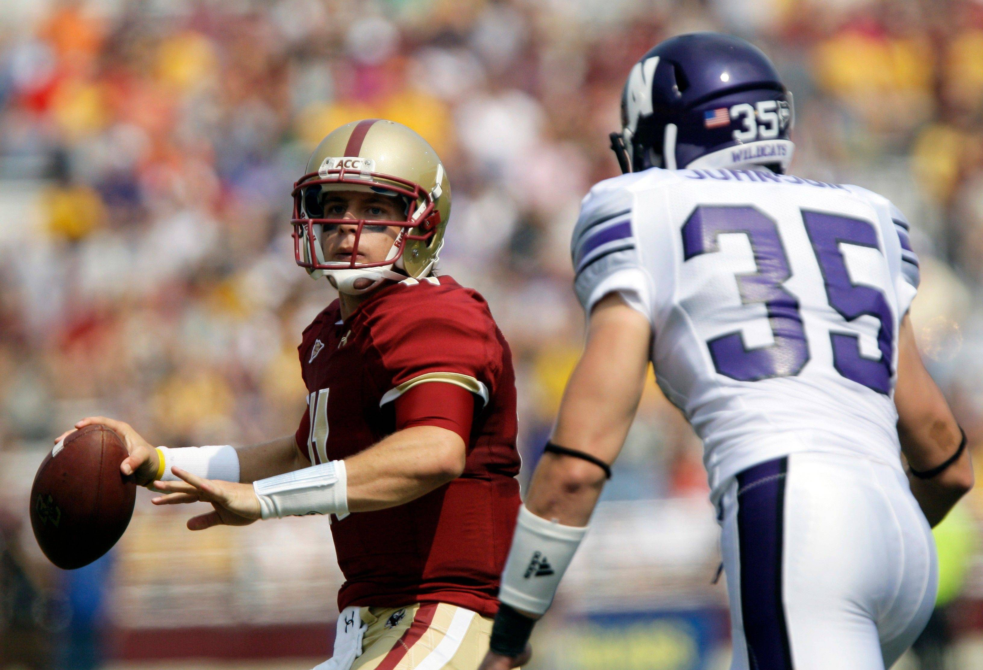 Boston College quarterback Chase Rettig looks to pass under pressure from Northwestern linebacker Ben Johnson (35) during the first half of an NCAA college football game, Saturday, Sept. 3, 2011, in Boston. (AP Photo/Mary Schwalm)