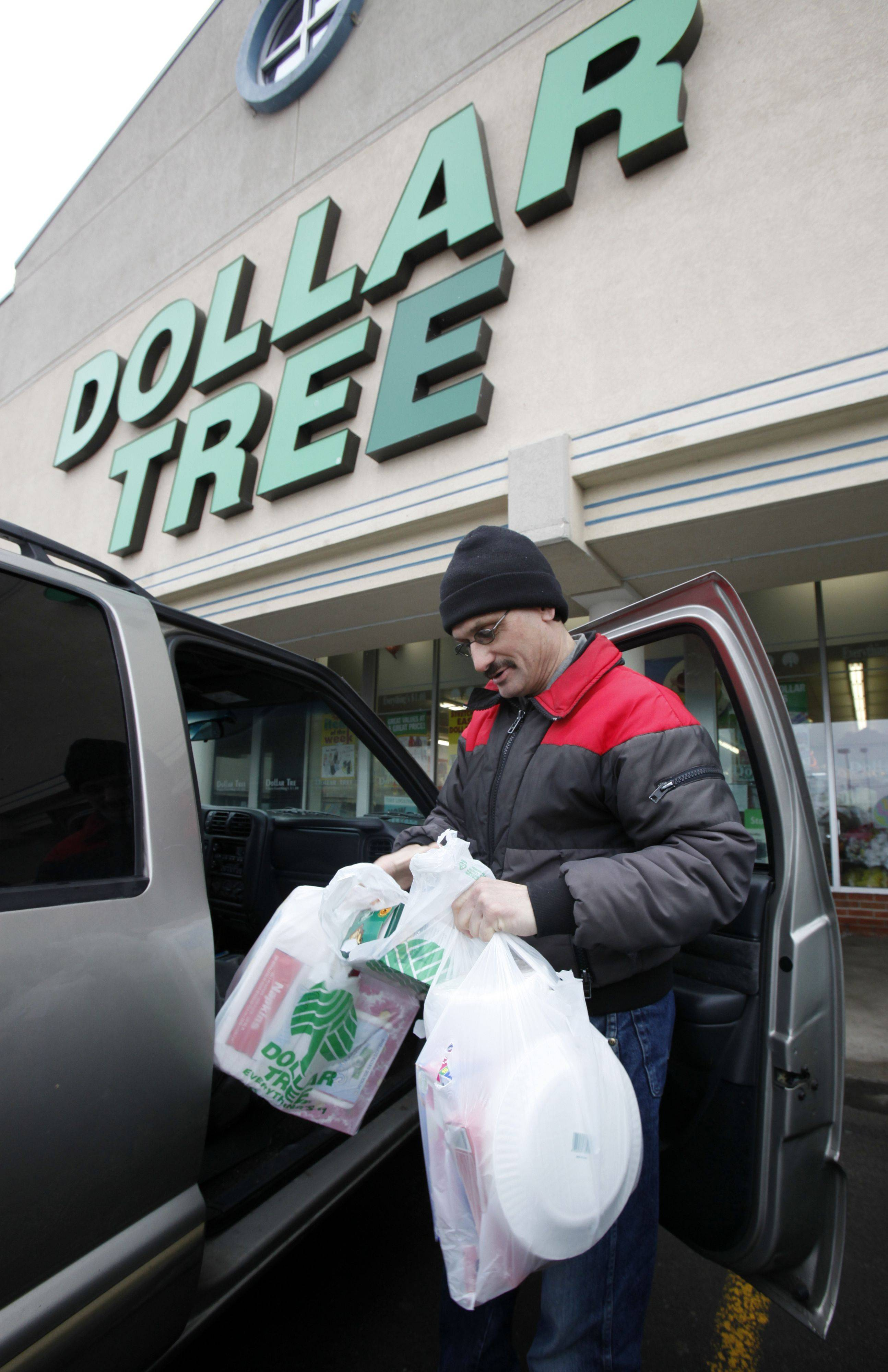 Larry Buckley leaves a Dollar Tree store in Batavia, N.Y. Last month, Dollar Tree Stores Inc. reported a 22 percent jump in quarterly earnings.