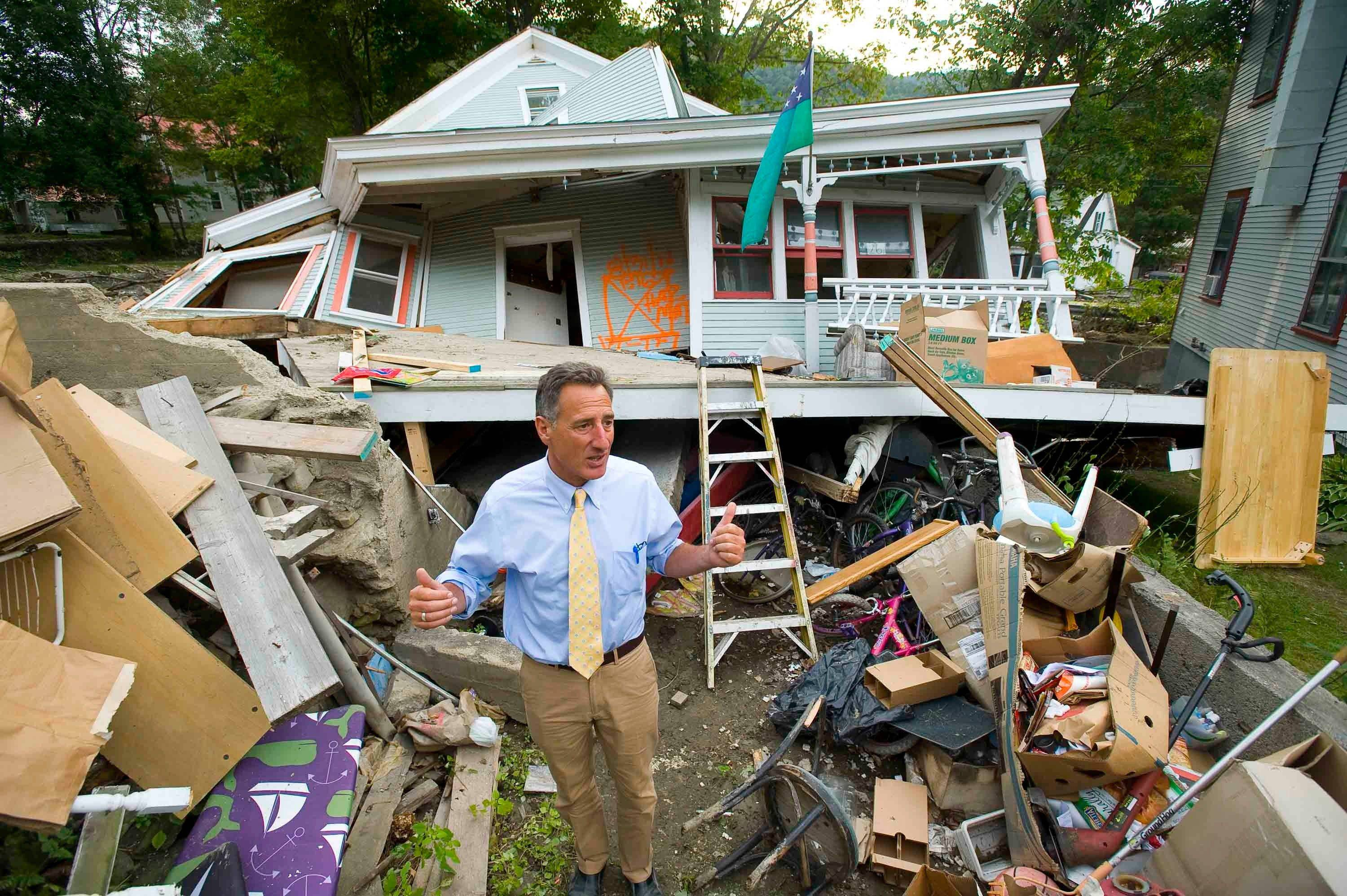 Associated Press Vermont Gov. Peter Shumlin surveys the damage to Jon Graham�s house on Wednesday in Rochester. Graham�s house was destroyed by waters from Hurricane Irene.
