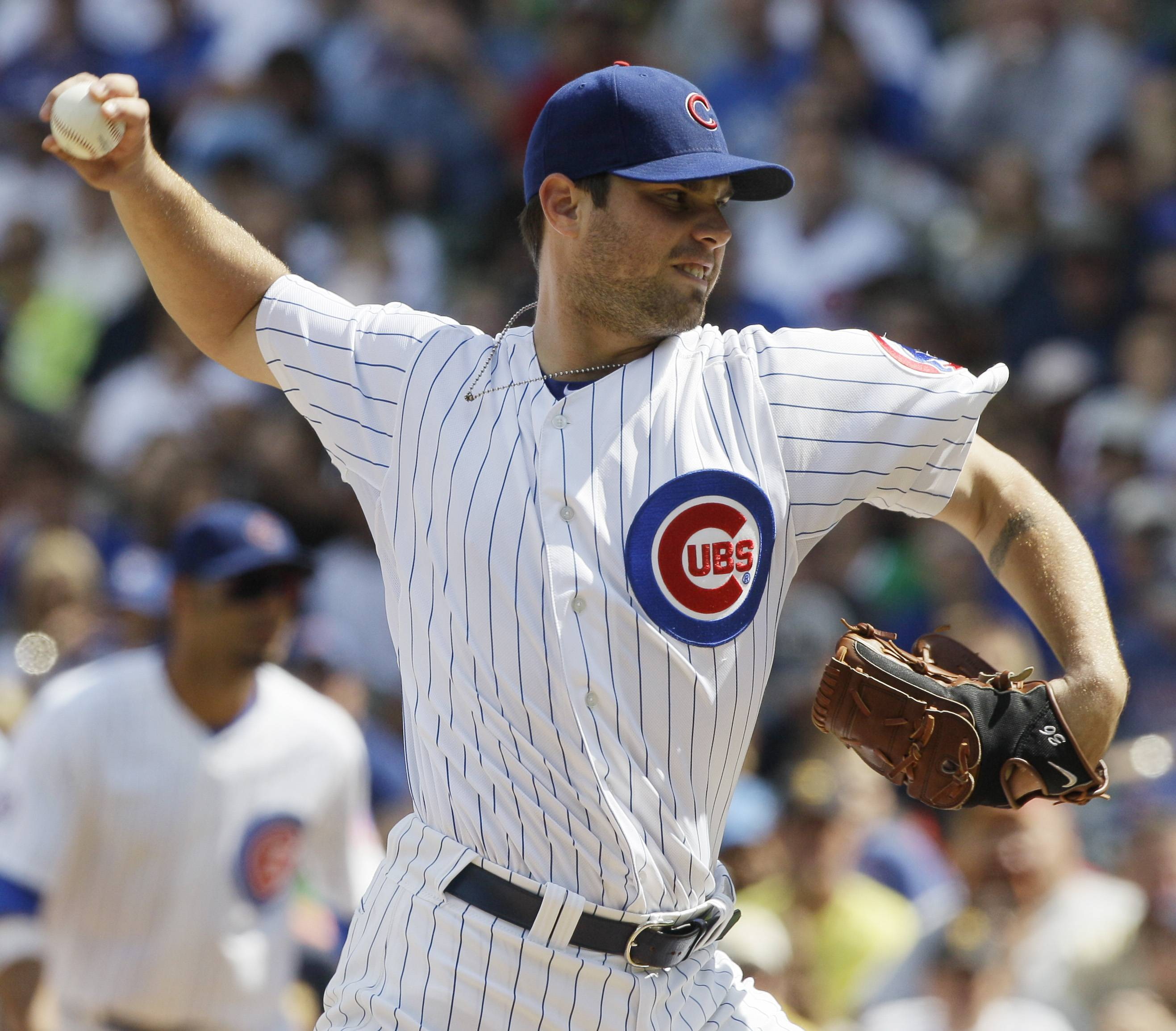 Chicago Cubs starter Randy Wells pitches during the first inning Sunday against the Pittsburgh Pirates in Chicago.