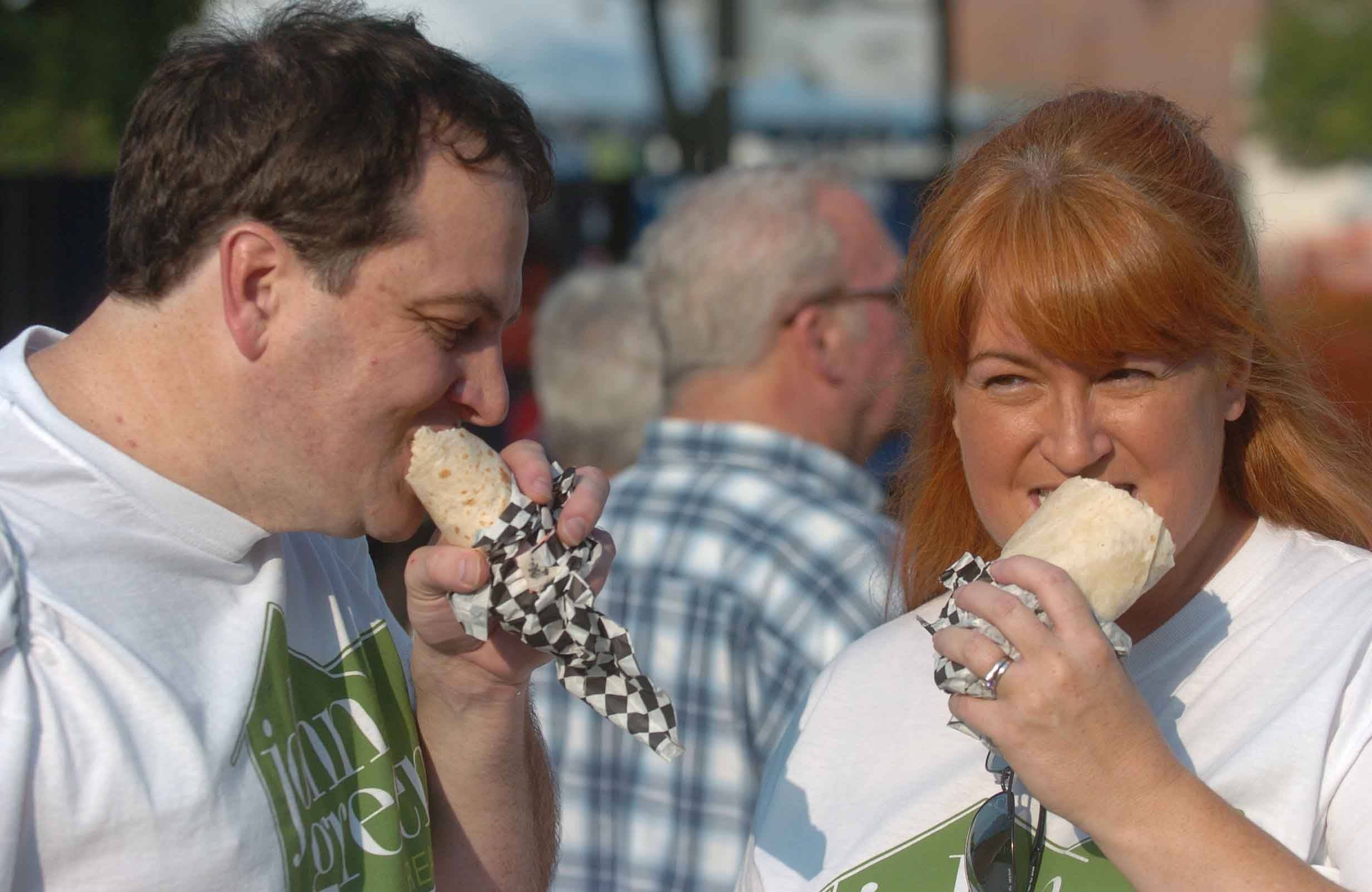 Kirk and Cassie Moore of Warrenville enjoy wraps during the Last Fling in Naperville Friday.