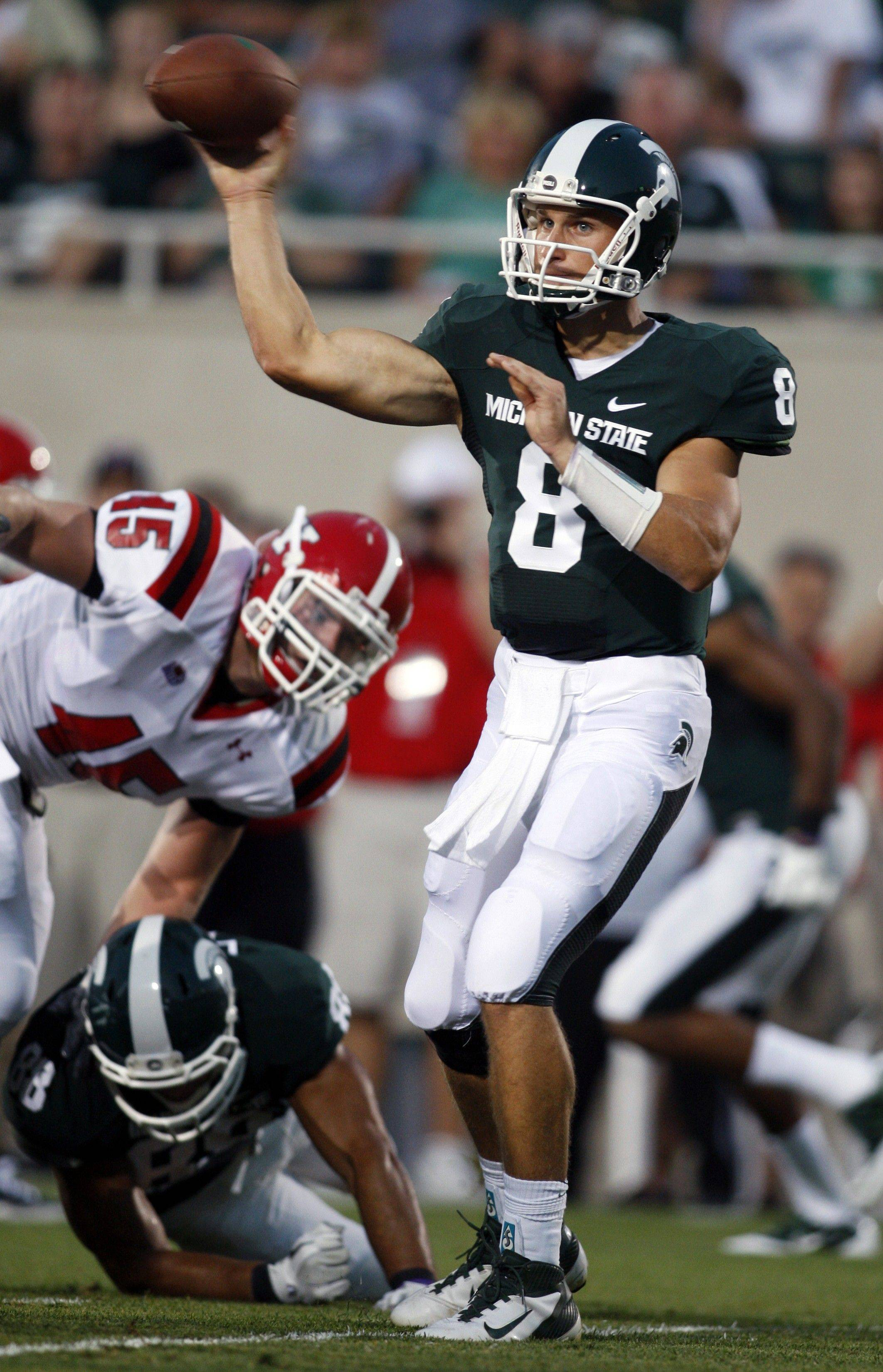 Michigan State quarterback Kirk Cousins, who grew up in Barrington before moving to Michigan, throws a pass against Youngstown State during the Spartans� season opener Friday night.