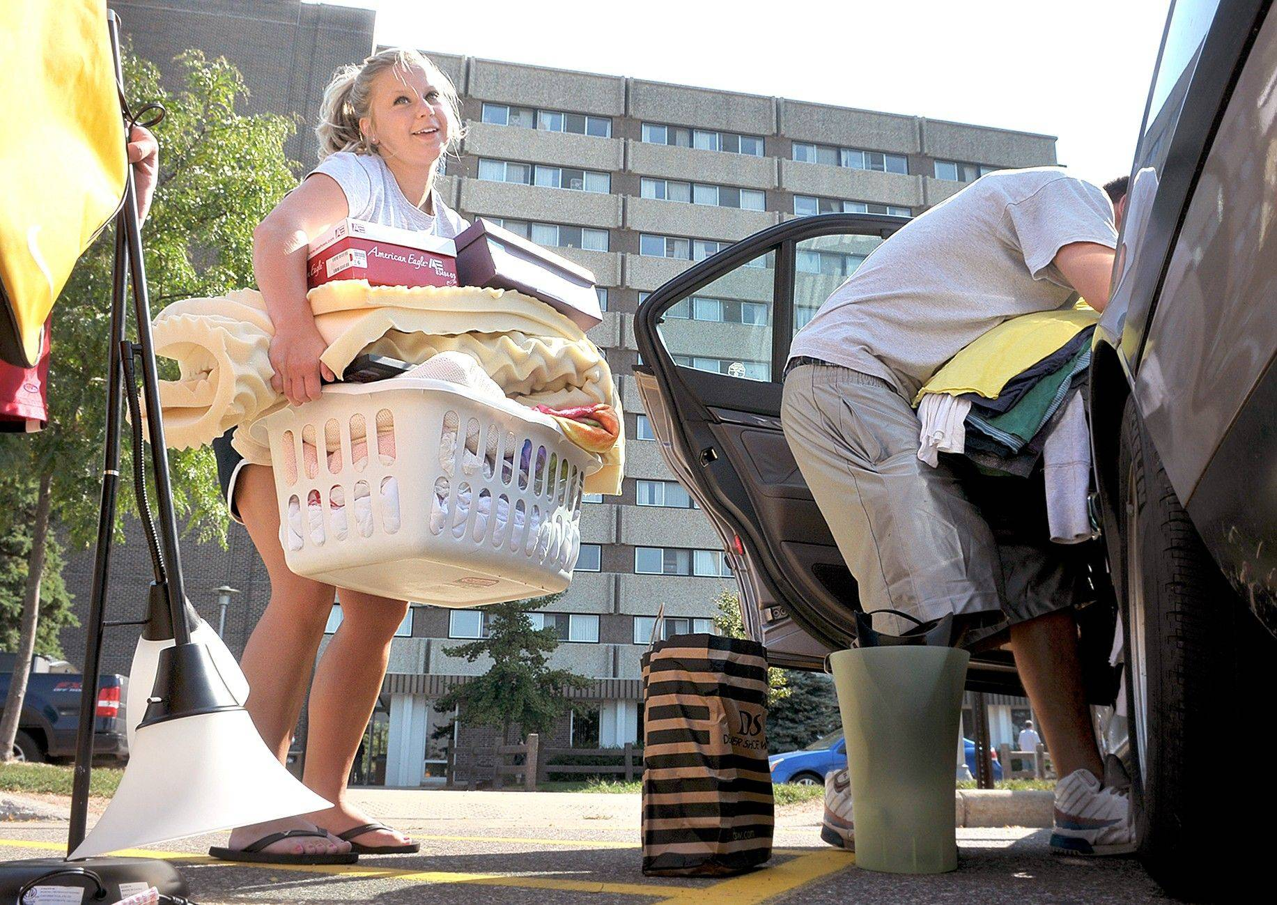 University of Wisconsin-Eau Claire students, Amber Brukardt, left, 19, and Mike Huberty, 18, move in to their dorms Thursday.