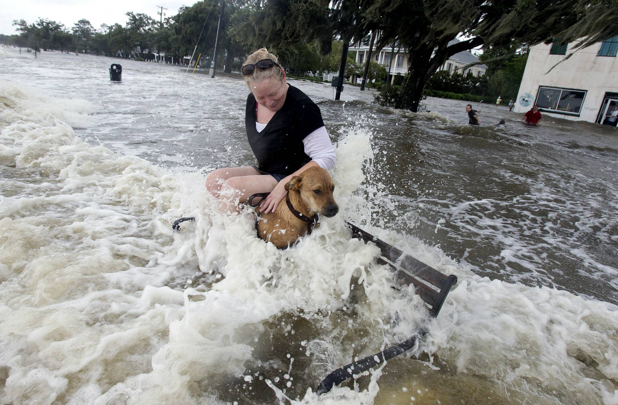 Holly Kennedy holds her dog as she watches the waves crash over the flood wall Sunday at the Mandeville, La., lakefront from Tropical Storm Lee. The vast, soggy storm system spent hours during the weekend hovering in the northernmost Gulf of Mexico. Its slow crawl to the north gave more time for its drenching rain bands to pelt a wide swath of vulnerable coastline, raising the flood threat.