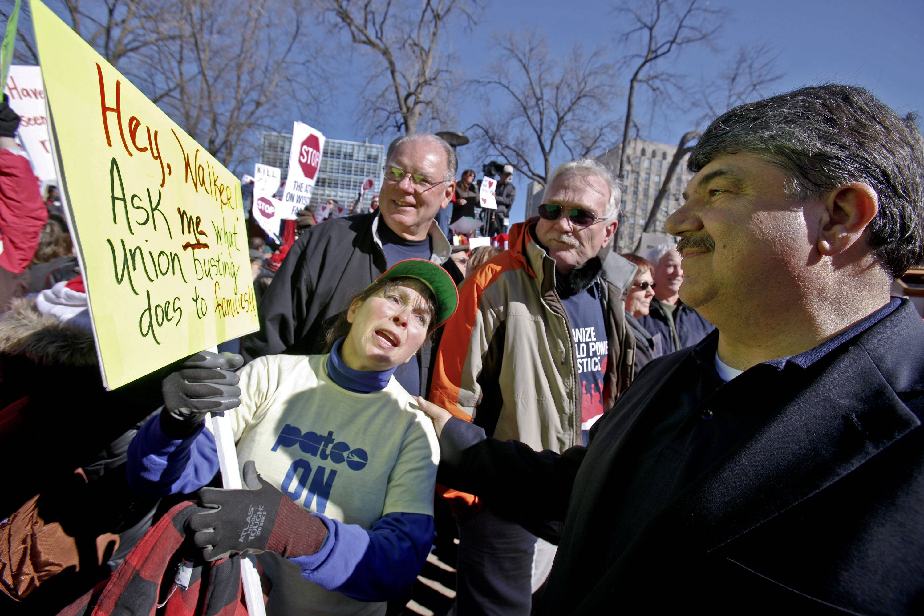 "In this Feb. 18, 2011, file photo AFL-CIO President Richard Trumka, right, talks with retired postal worker Judy Bukowski of Madson, Wis., outside of the State Capitol in Madison, where union members, students, and others protested against the governor's bill to eliminate collective bargaining rights for many state workers. the early days of the Obama administration, organized labor had grand visions of pushing through a sweeping agenda that would help boost sagging membership and help revive union strength, but frustration with President Barack Obama reached new heights this summer as Trumka accused him of working with tea party Republicans on deficit reduction instead of ""stepping up to the plate"" on jobs."