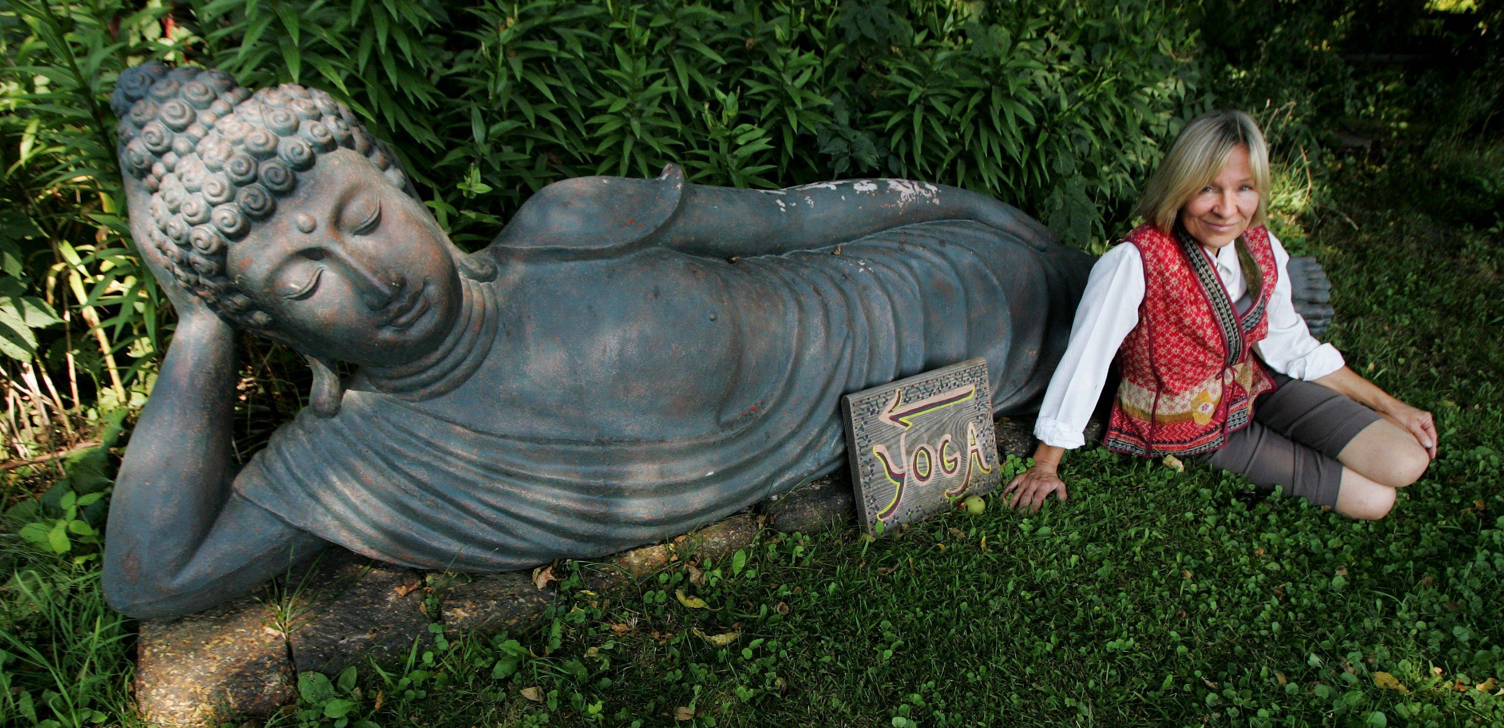 Relaxing with a reclining Buddha she brought home from one of her many adventures, Ginger Blossom has turned her Gauger family farm in Richmond into the Ginger Blossom import business that sells fair-trade products from around the globe.