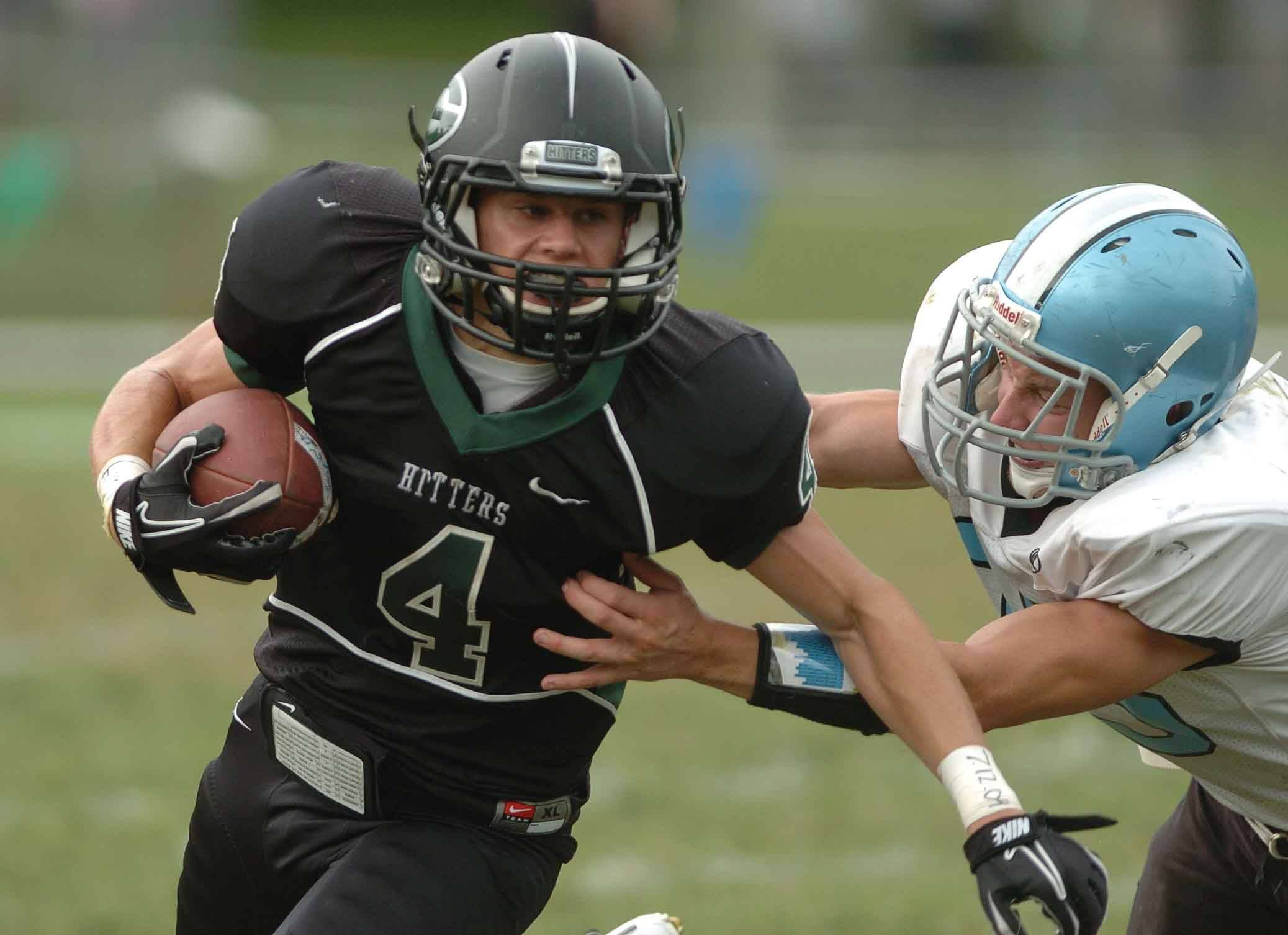 Matthew Marston of Glen Ellyn on the run during the Willowbrook at Glenbard West Football game Saturday.