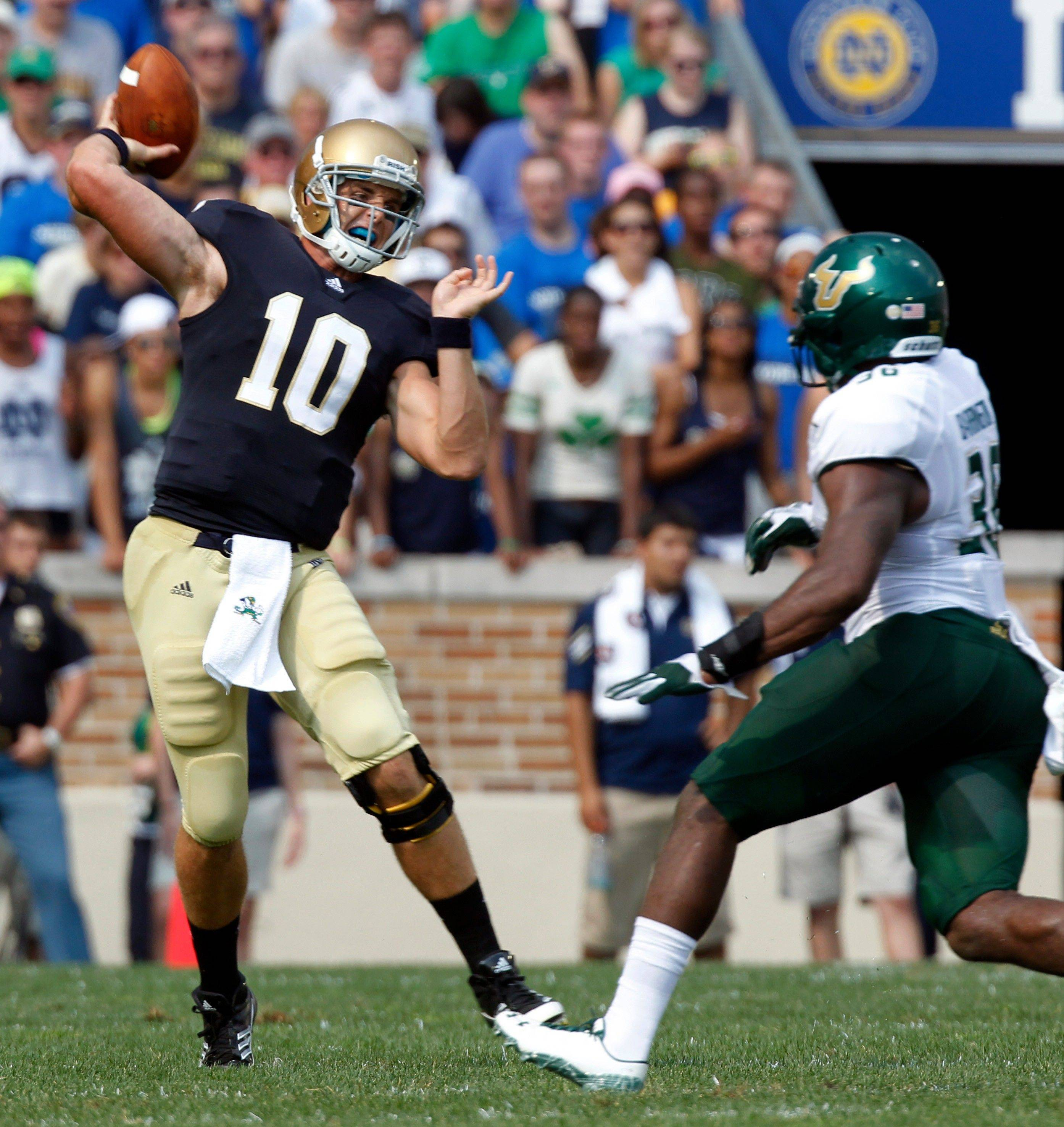 Dayne Crist makes a throw under pressure during the first half Saturday in South Bend, Ind. Crist completed just 7 of 15 passes and threw an interception in the end zone during Notre Dame's 23-20 loss to South Florida.