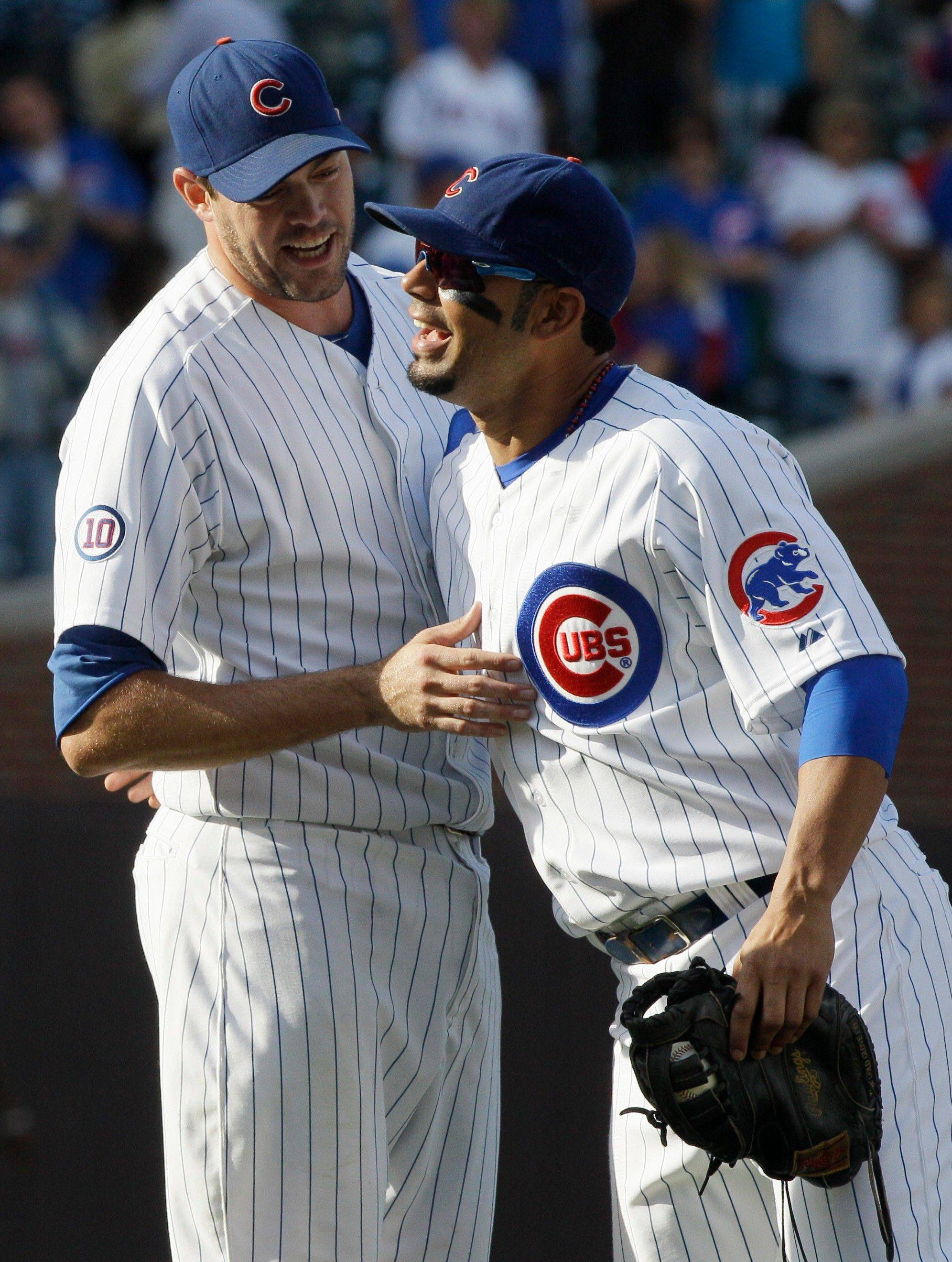 Sean Marshall, left, celebrates with Carlos Pena after the Cubs defeated the Pirates on Sunday. It was Marshall's fourth save of the season.