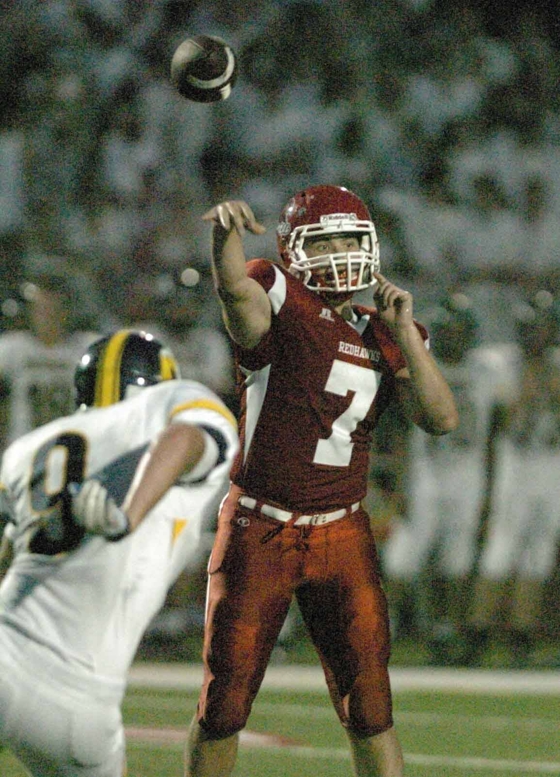 Naperville Central QB Ian Lewandowski of Naperville fires downfield during the Redhawks� 28-14 victory over Neuqua Valley on Friday.