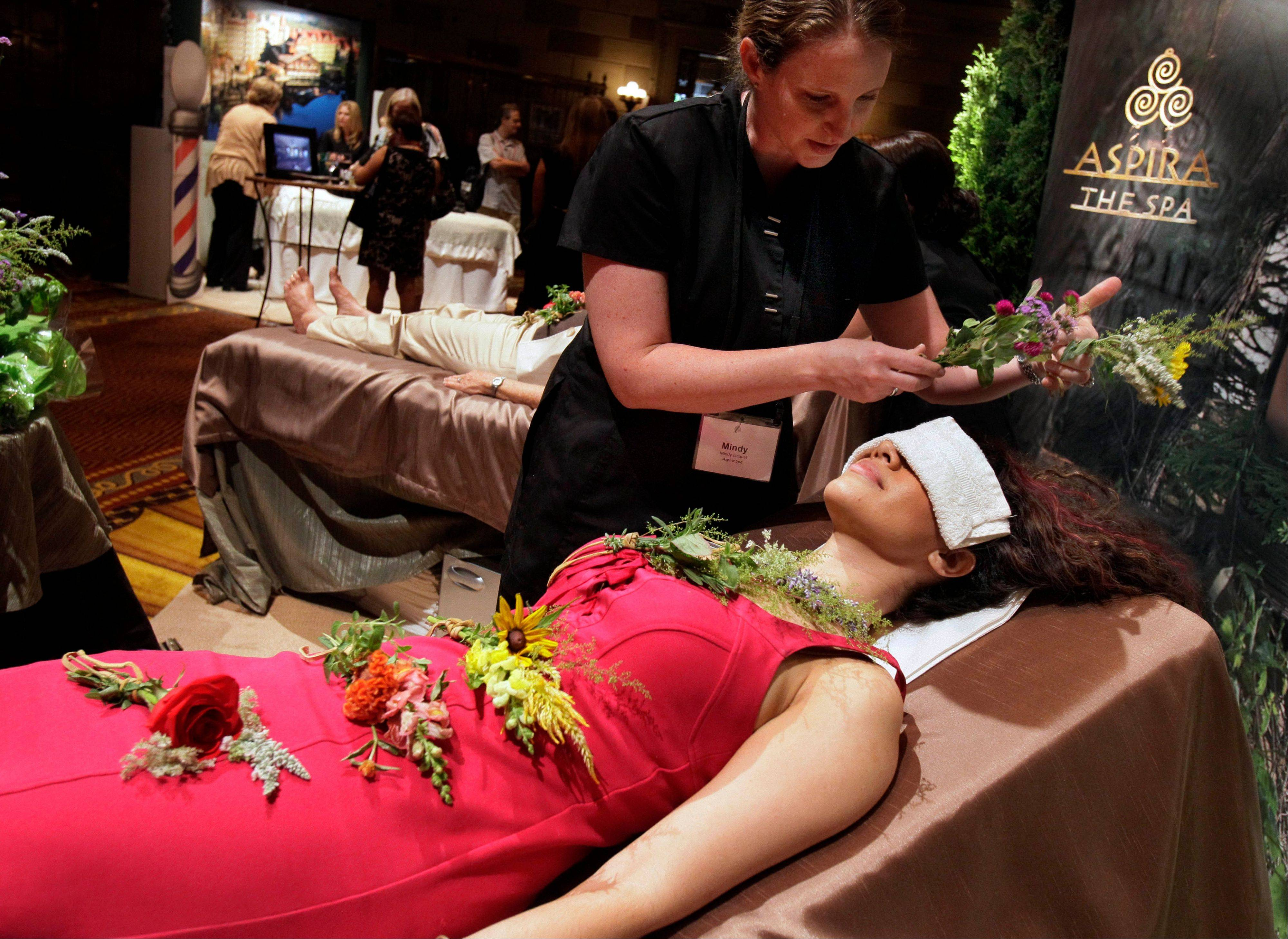 A woman as she receives a Chakra Garden Massage at The Osthoff Resort, in Elkhart Lake, Wis. Hyperlocal ingredients, a blend of high tech and tradition, and treatments focusing not just on skin, nails and hair but also on remedying stress and pain are some of the latest trends turning up at spas.