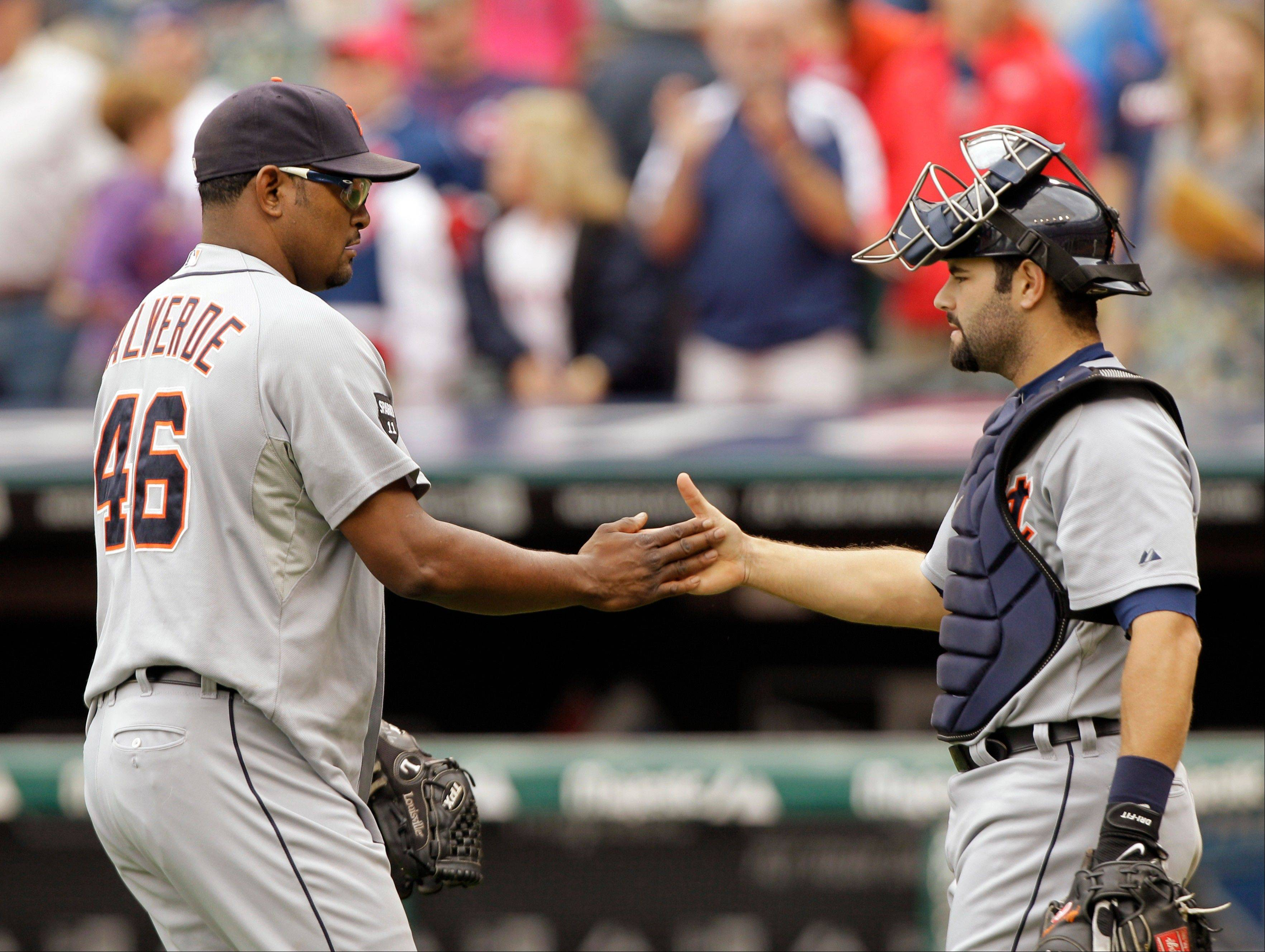 Detroit Tigers relief pitcher Jose Valverde (46) and catcher Alex Avila celebrate a 4-2 win over the Cleveland Indians in a baseball game Monday in Cleveland.