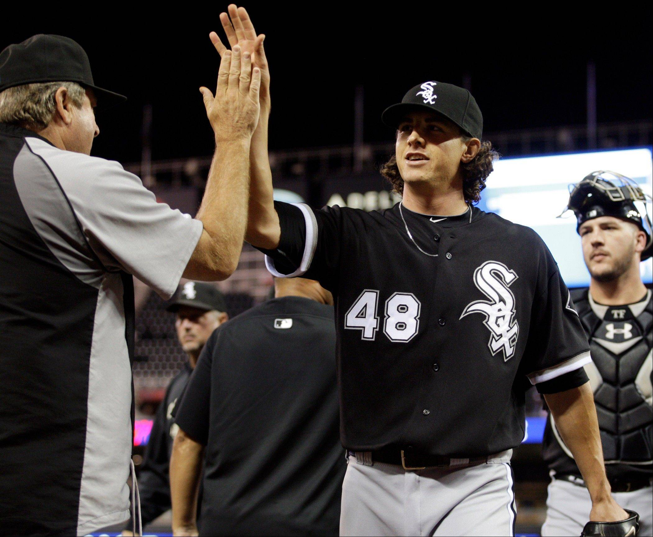 White Sox starter Zach Stewart is congratulated after his 1-hitter Monday night.
