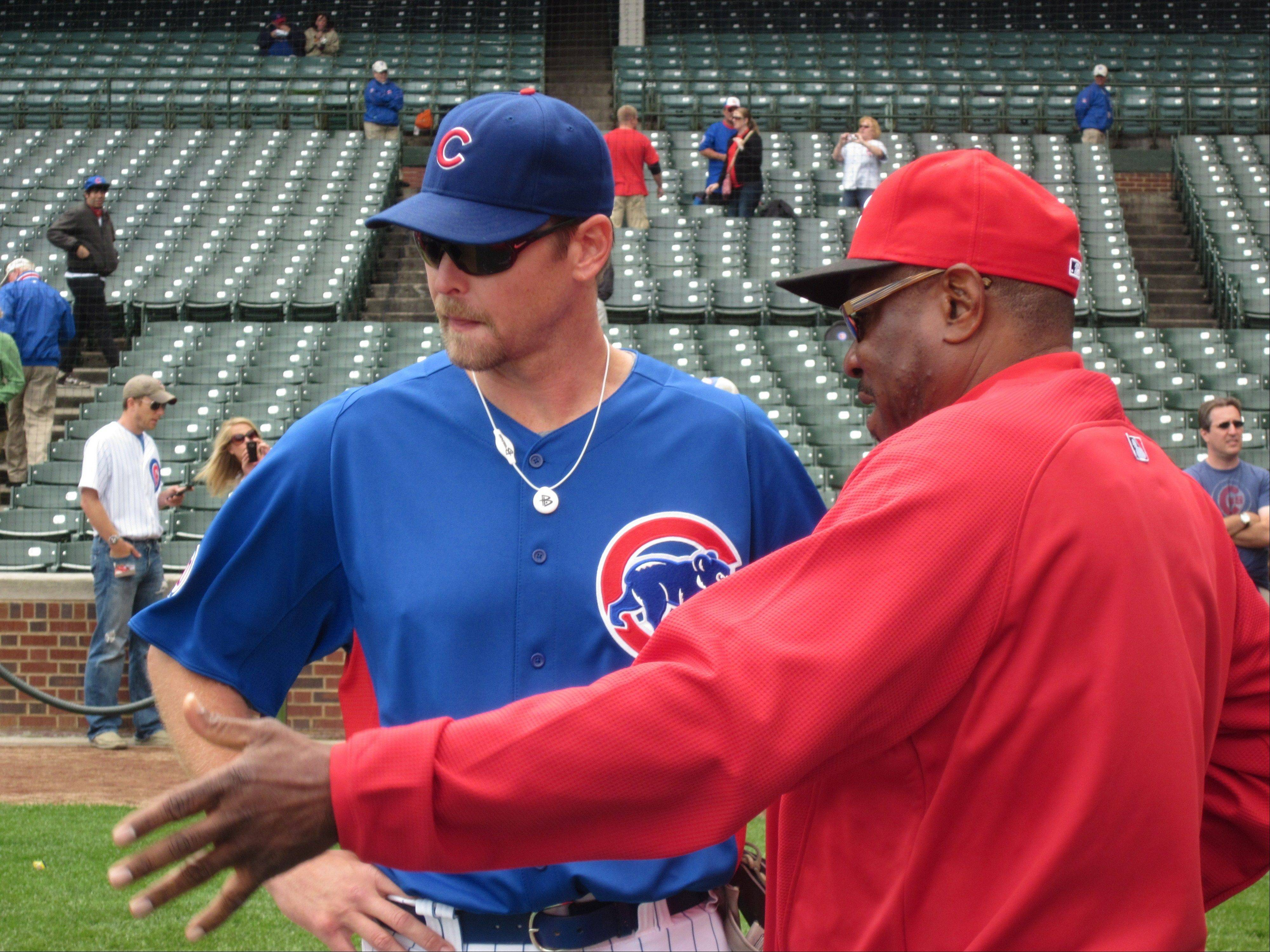 Cubs reliever Kerry Wood talks with Reds manager Dusty Baker before Monday's game at Wrigley Field.