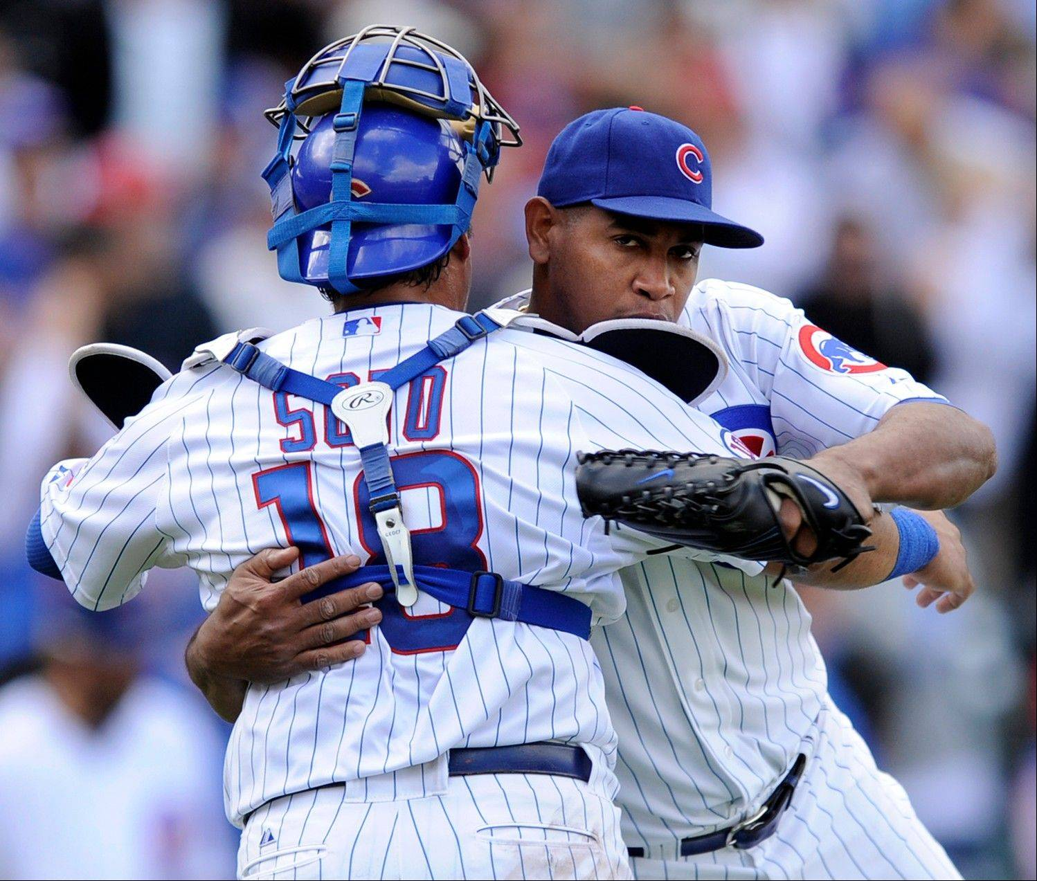 Cubs closer Carlos Marmol celebrates with catcher Geovany Soto after earning the save in Monday's victory over the Reds at Wrigley Field.