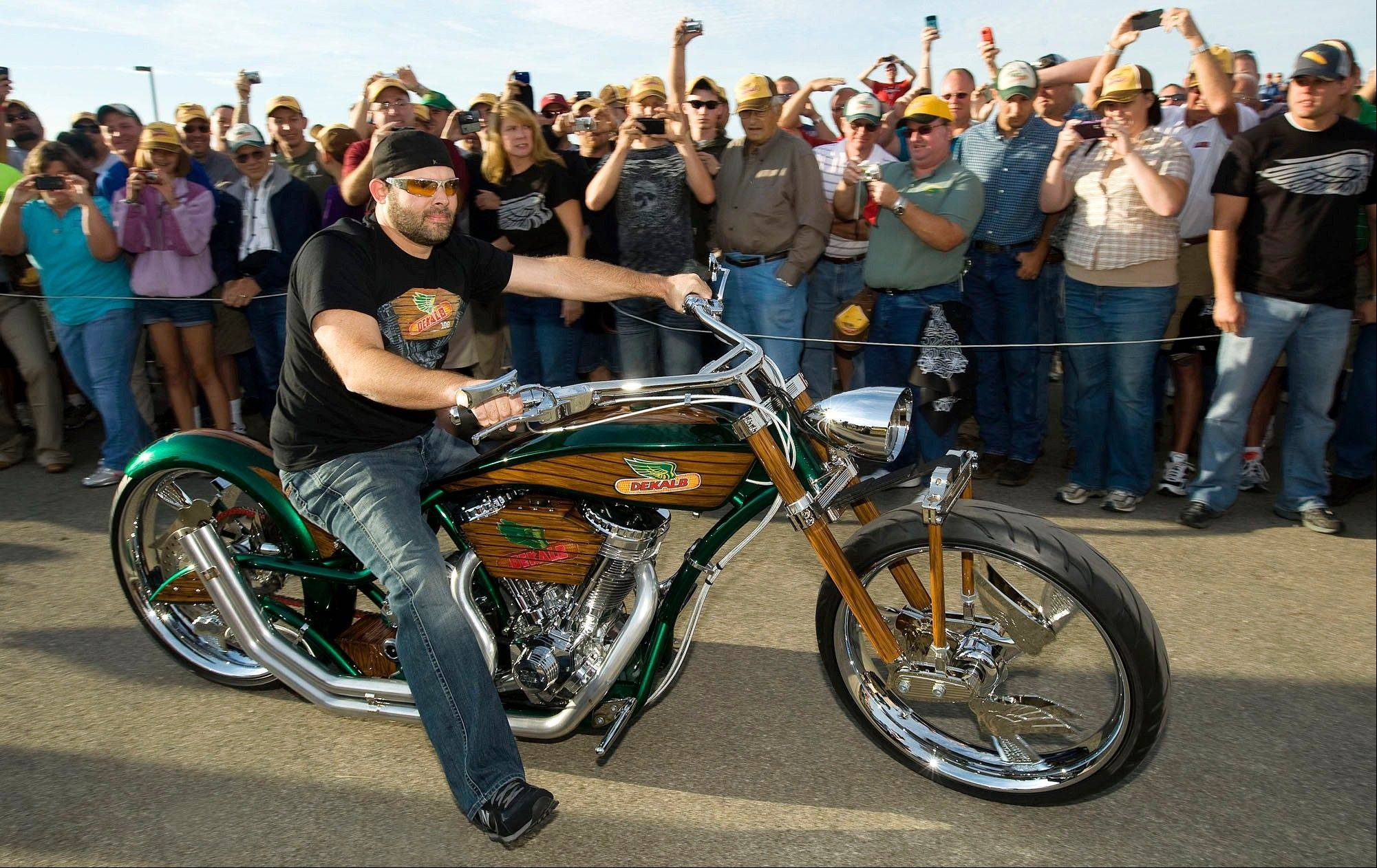 "Paul Jr. Designs owner Paul Teutul Jr., from the television show ""American Chopper,"" unveiled the DEKALB Seeds chopper at the 2011 Farm Progress Show in Decatur."