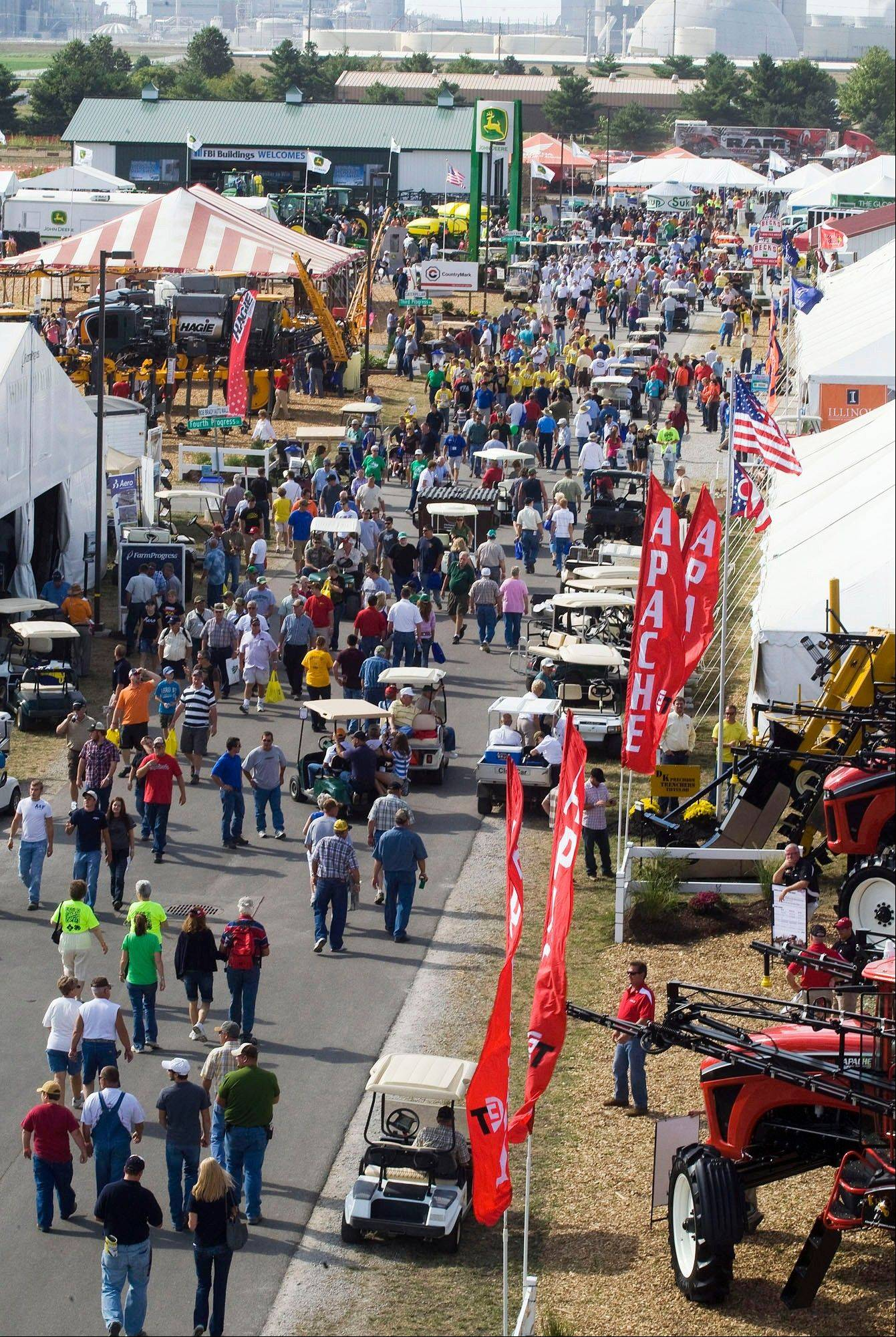 Visitors to the 2011 Farm Progress Show flock to their favorite vendors in Decatur.