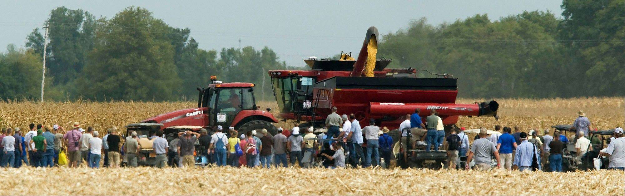Visitors to the 2011 Farm Progress Show in Decatur, line the ropes to watch the field demonstrations.