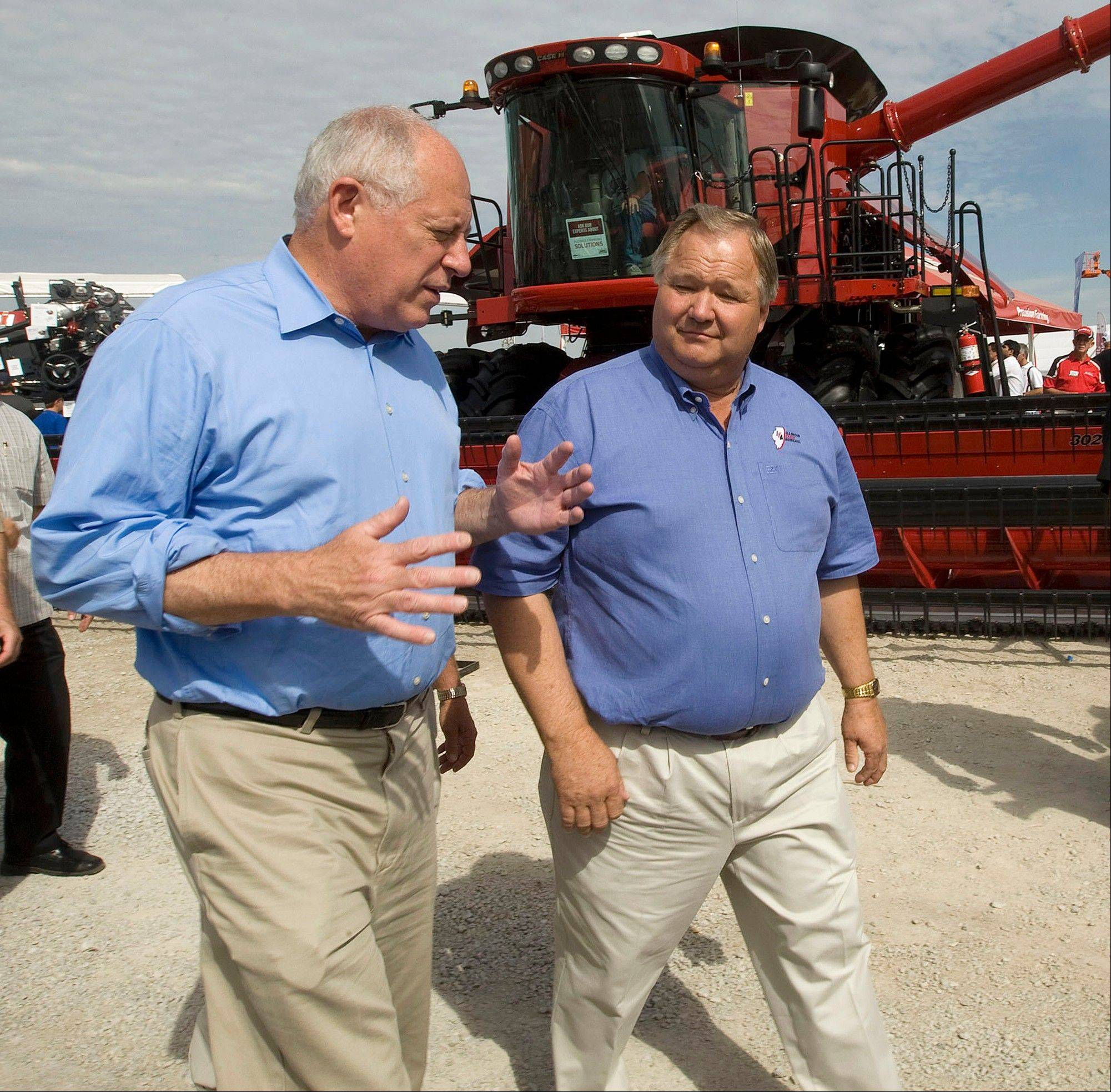 Illinois Gov. Pat Quinn walks with Illinois Farm Bureau President Philip Nelson as they tour the grounds of the 2011 Farm Progress Show in Decatur.