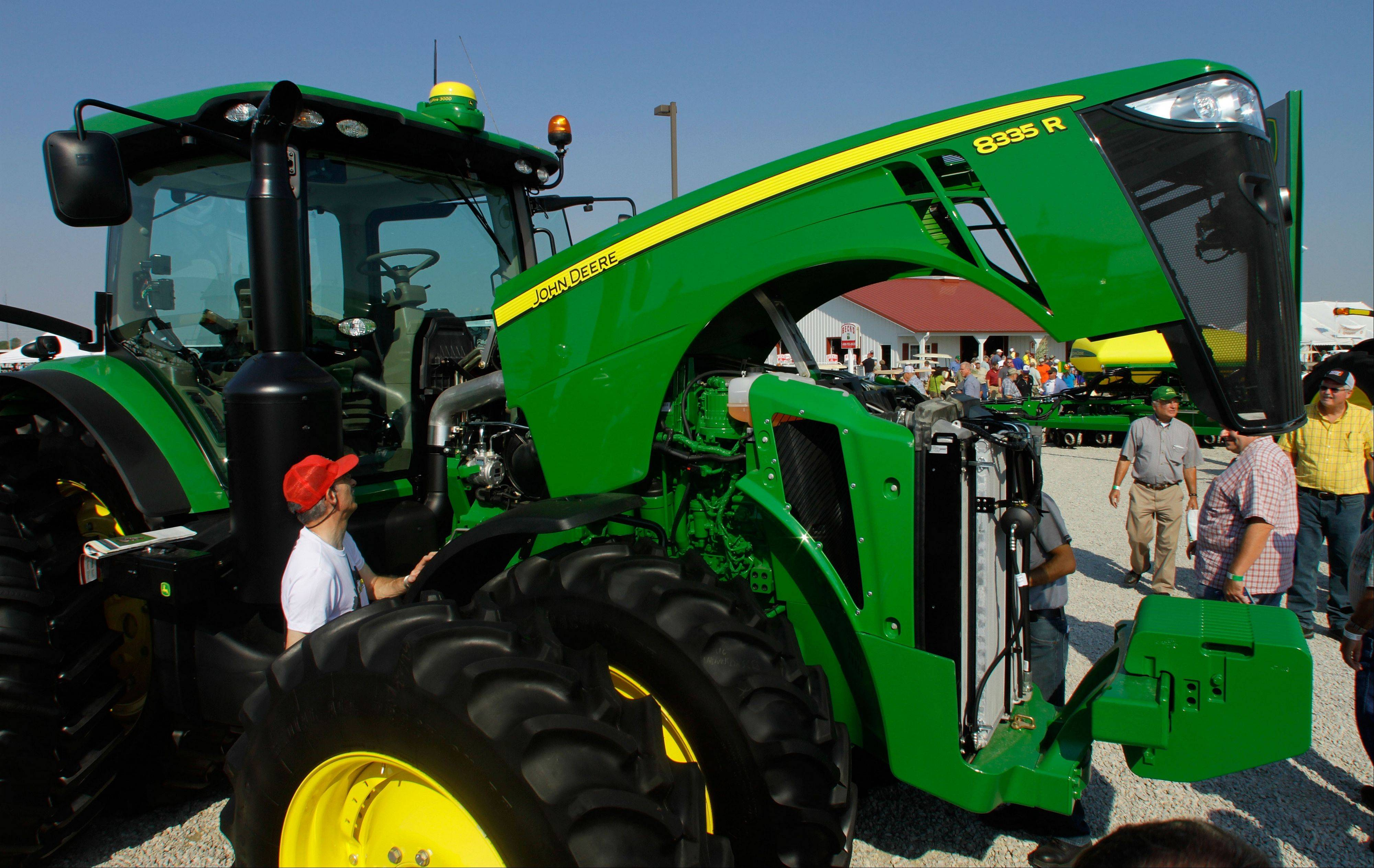 Ed Kach of Chillicothe, left, examines a John Deere tractor during the Farm Progress Show in Decatur.