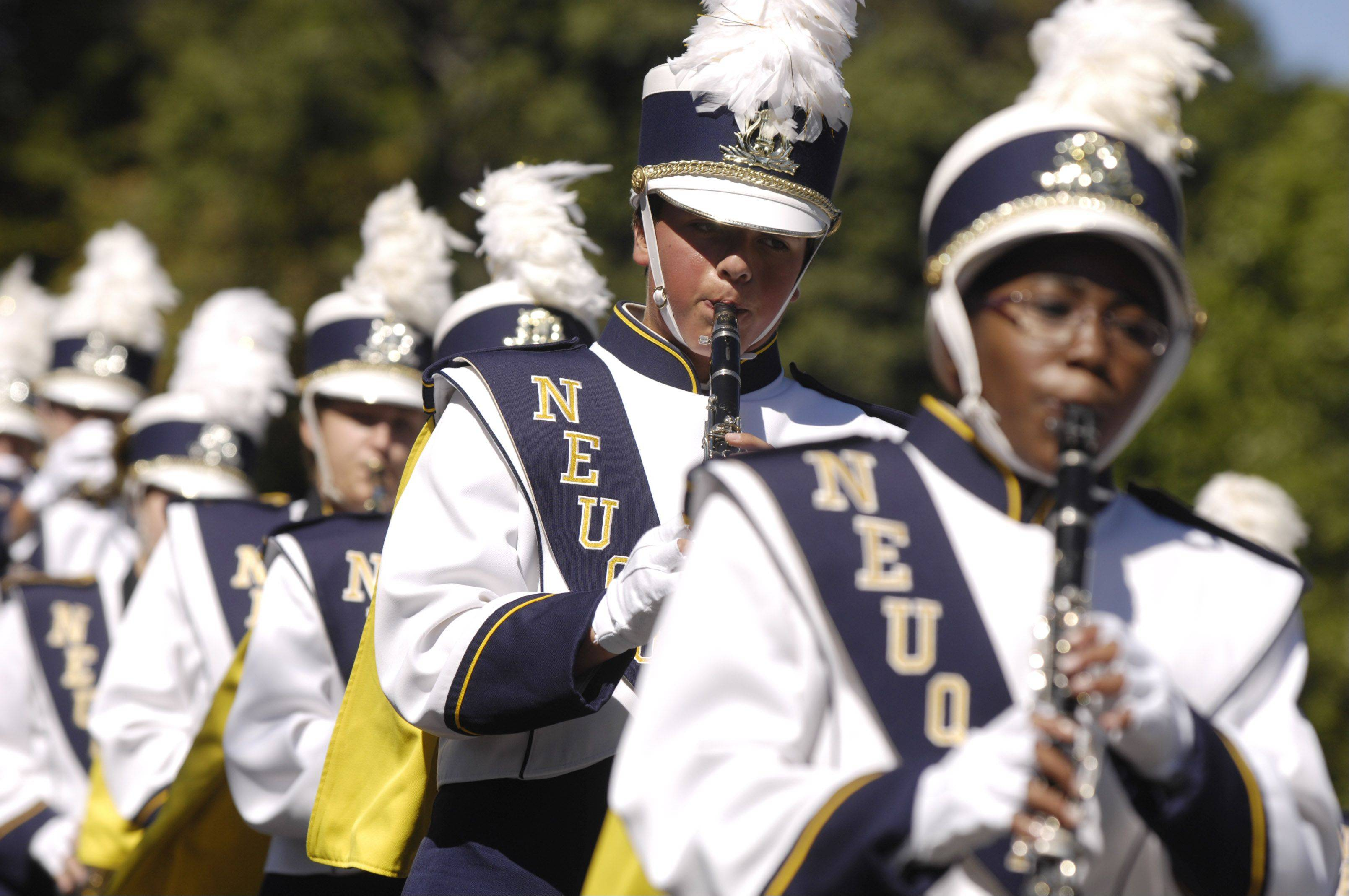 The Neuqua Valley High School marching band performs during Naperville's Last Fling summer parade Monday.