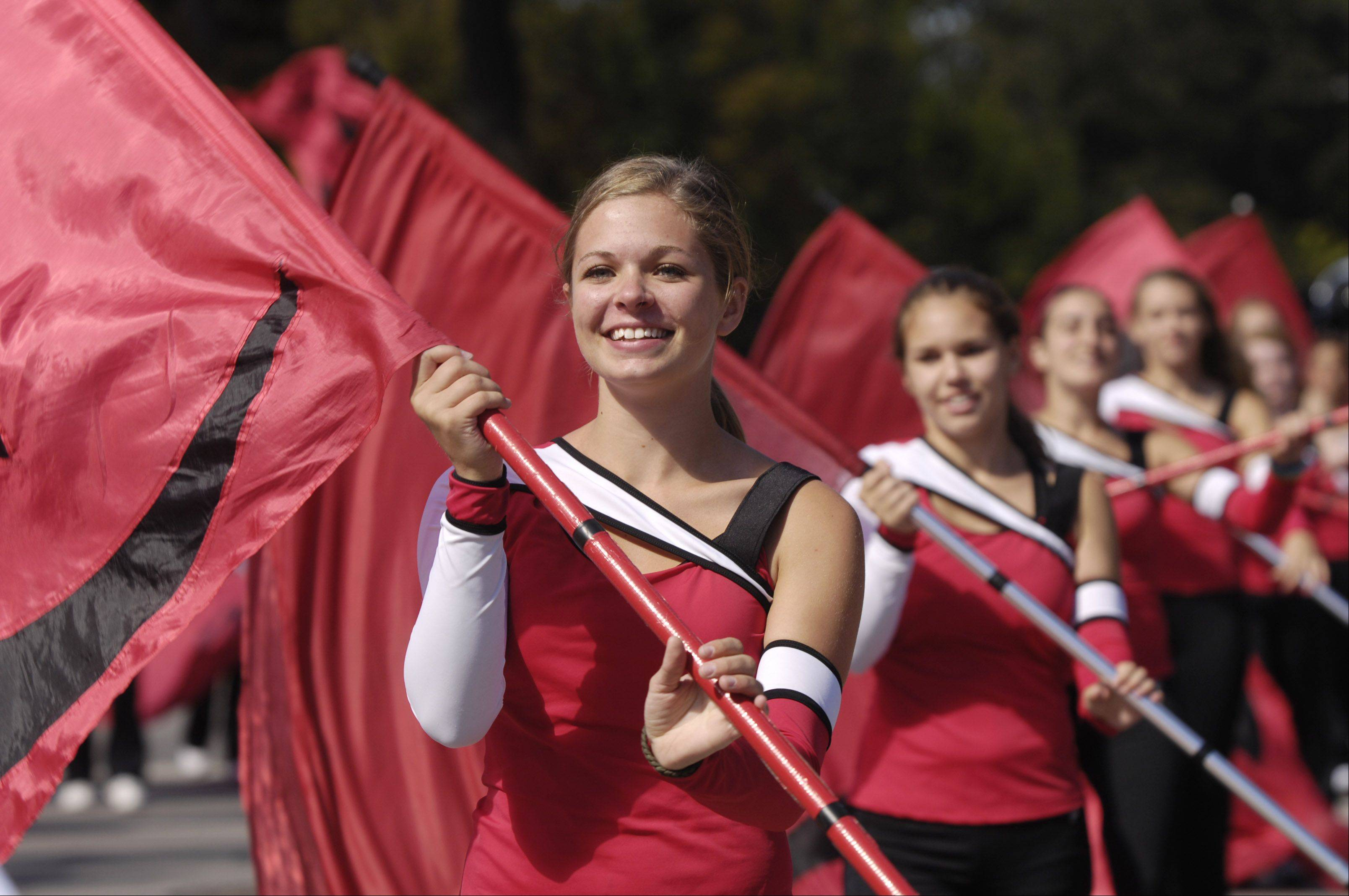 The Naperville Central High School flag choir performs during the Last Fling Labor Day parade.