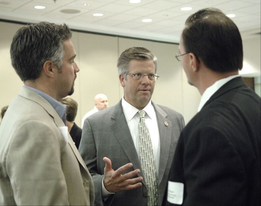 Congressman Randy Hultgren talks to Eric Mancke, left, of Cemcon Ltd. in Aurora and Dan Olsem of Crown Community Development in Naperville after addressing the Elgin Area Chamber on last week.