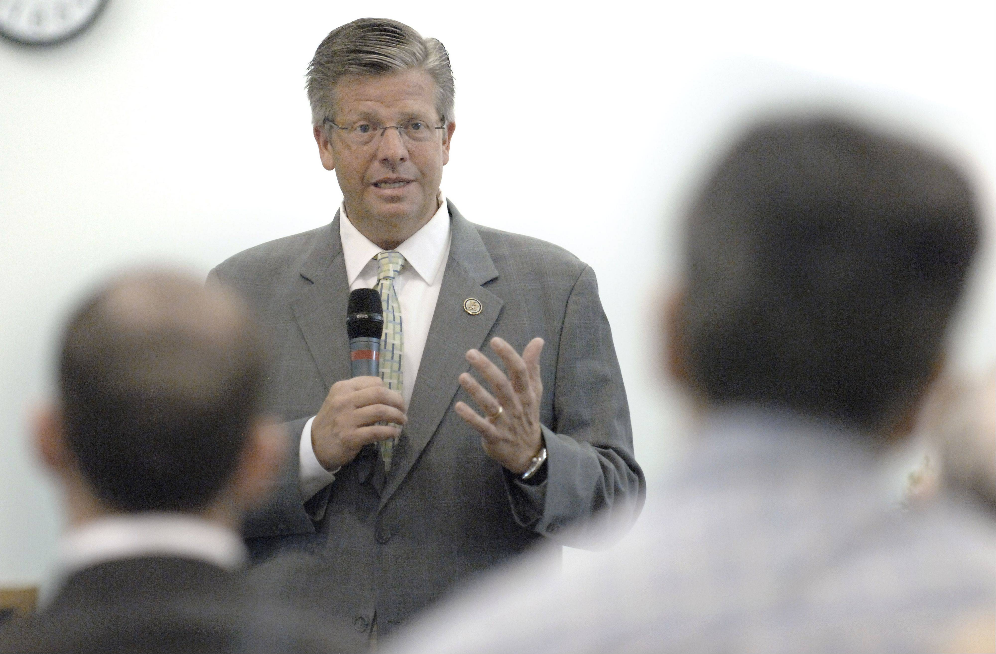 Congressman Randy Hultgren answers a question at an Elgin Area Chamber meeting last week.