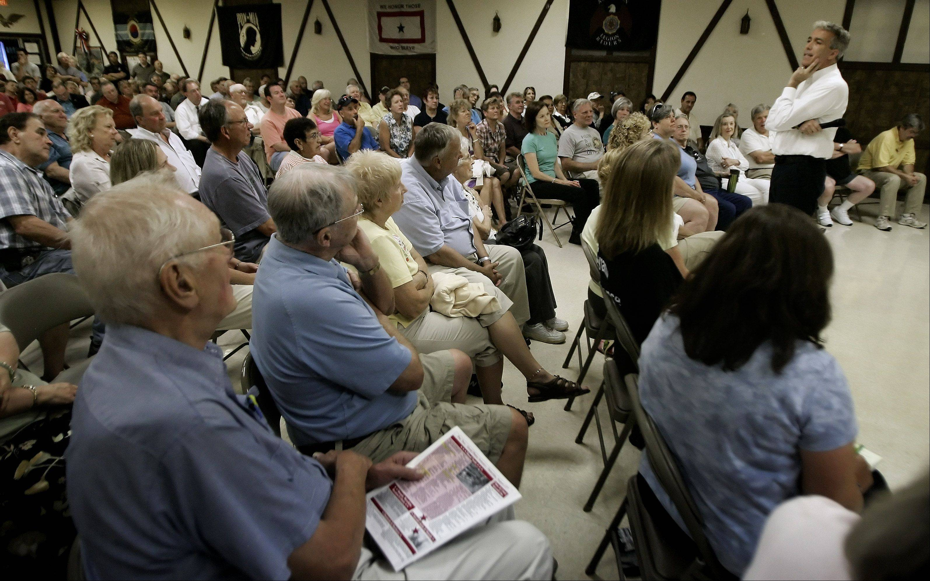 Congressman Joe Walsh answers questions during a recent town hall meeting at the American Legion Hall in Wauconda.