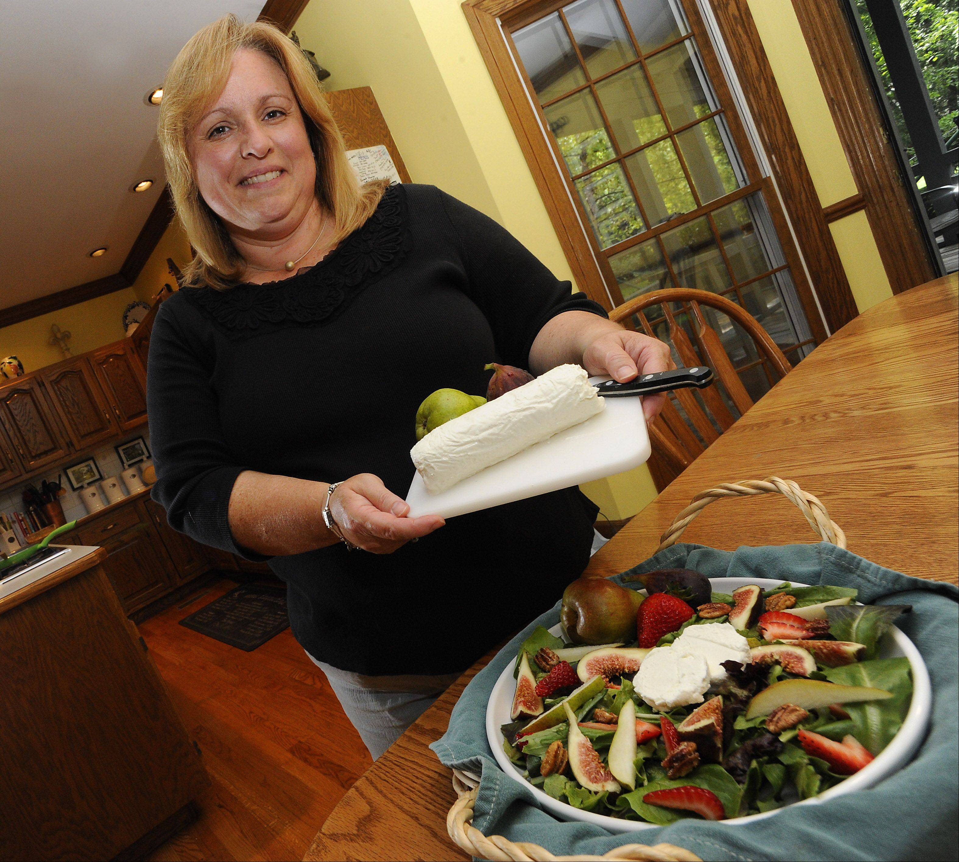 Mark Welsh/mwelsh@dailyherald.com Cook of the Week Challenge contestant Penny Kazmier of South Barrington with Goat Cheese her favorite ingredient in her foods.