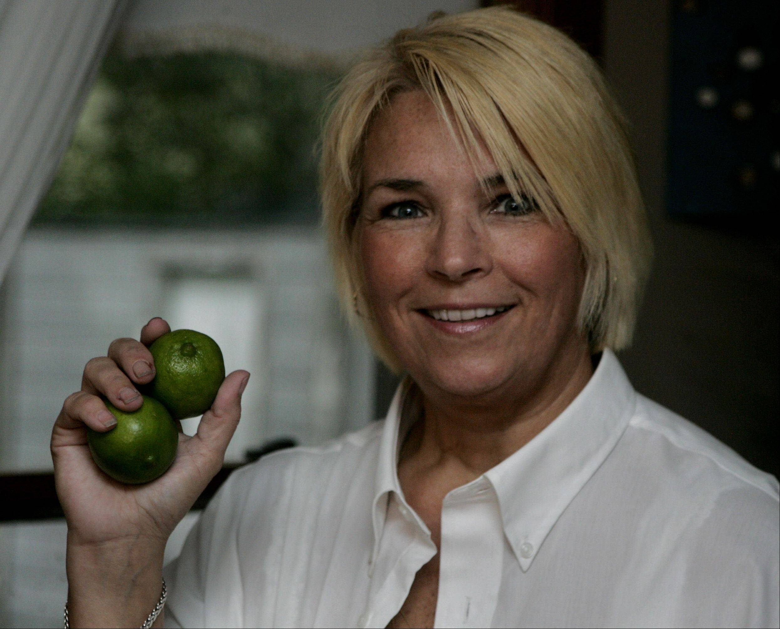 Cook of the Week Challenge contestant Cate Brusenbach of Antioch with her favorite ingredient, limes.