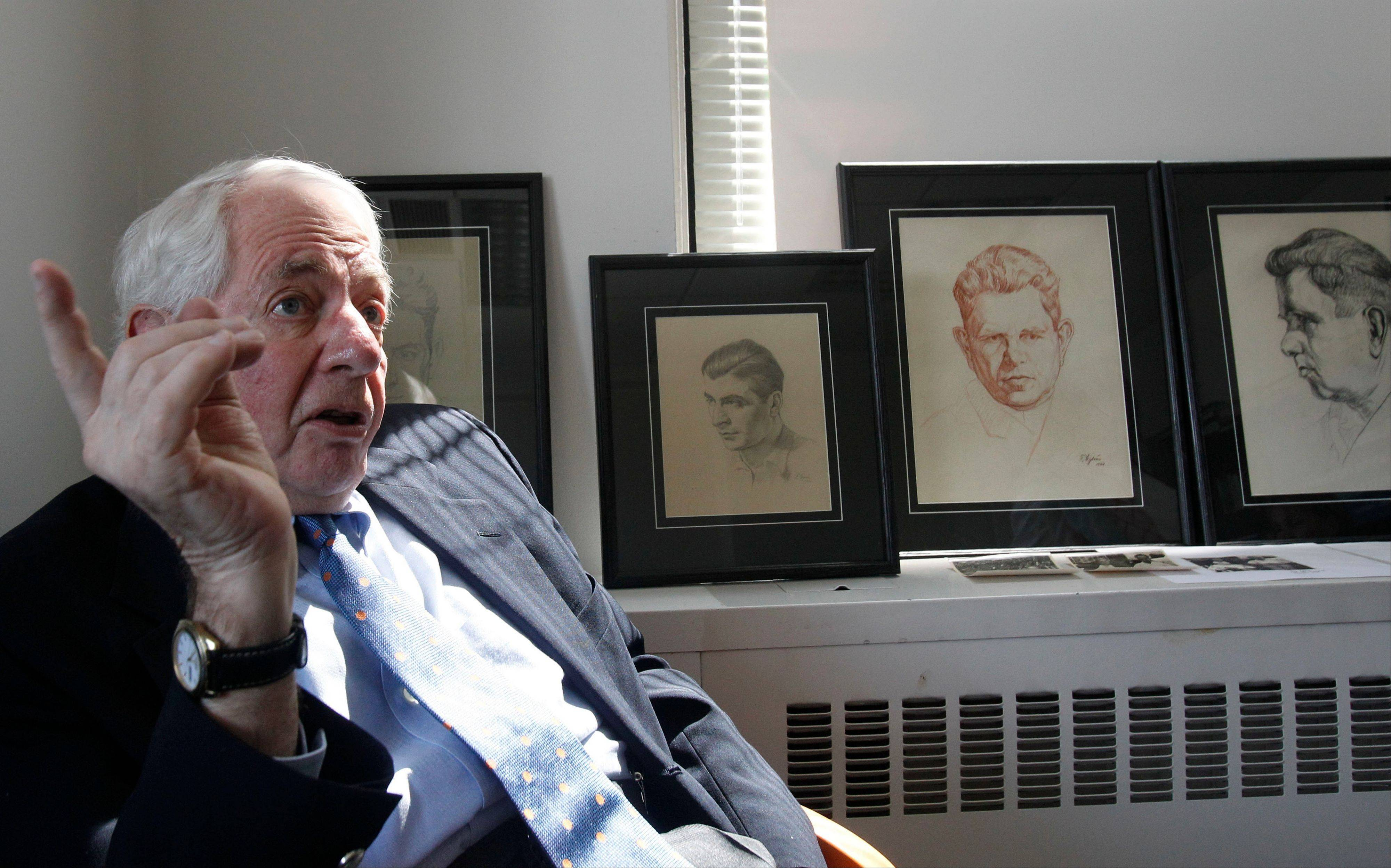 Author Lawrence Malkin with a collection of portraits of German concentration prisoners by Felix Cytrin at the American Society for Yad Vashem in New York after the portraits were donated by Cytrin heirs to Yad Vashem, Israeli's Holocaust remembrance museum.