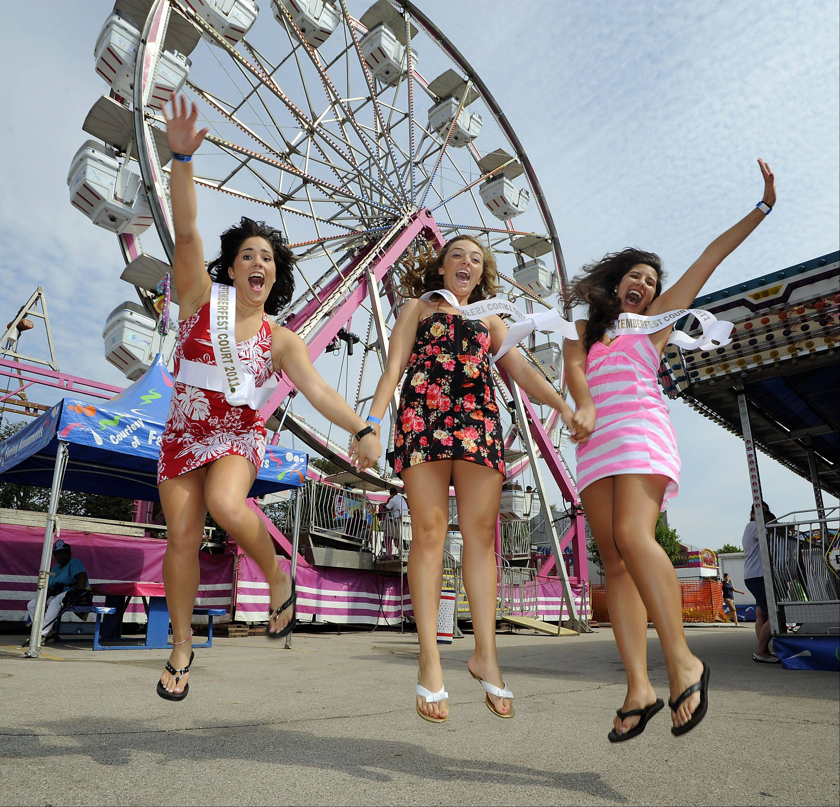 Michelle Klages, 17, Jackie Keegan, 17, and Natalie Chakeves, 19 — members of the Miss Septemberfest court — jump with excitement on the first day of the three-day event Saturday. Although officials are still awaiting final attendance figures, preliminary results had them on Tuesday declaring the fest an unqualified success.